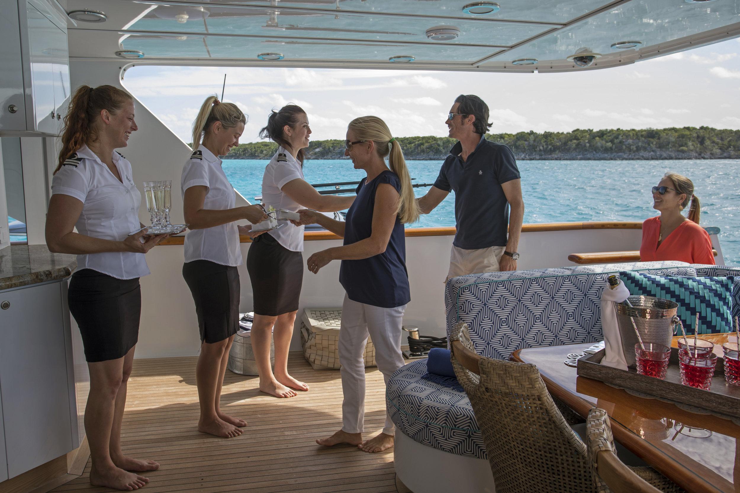yacht-sweet-escape-crew-teak-welcome-luxury-golf-onboard