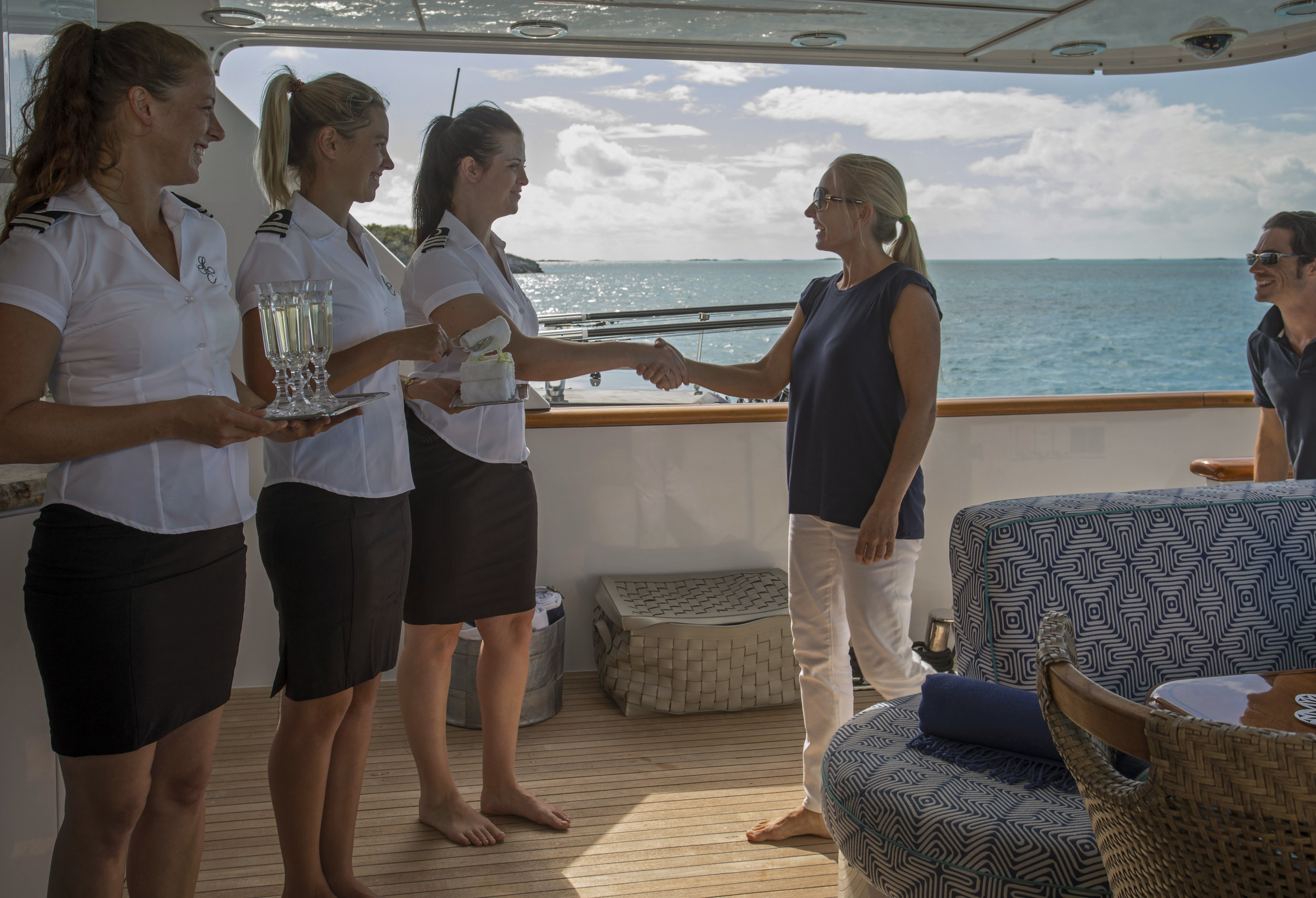 yacht-sweet-escape-crew-teak-welcome-luxury-Day-charter-rose-island