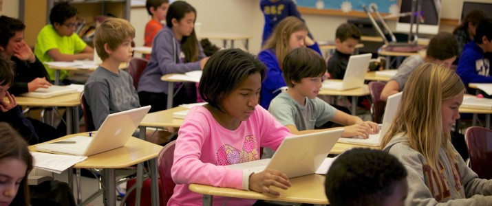 Thinkers_classroom_girl-in-pink-shirt-with-computer-715x300.jpg