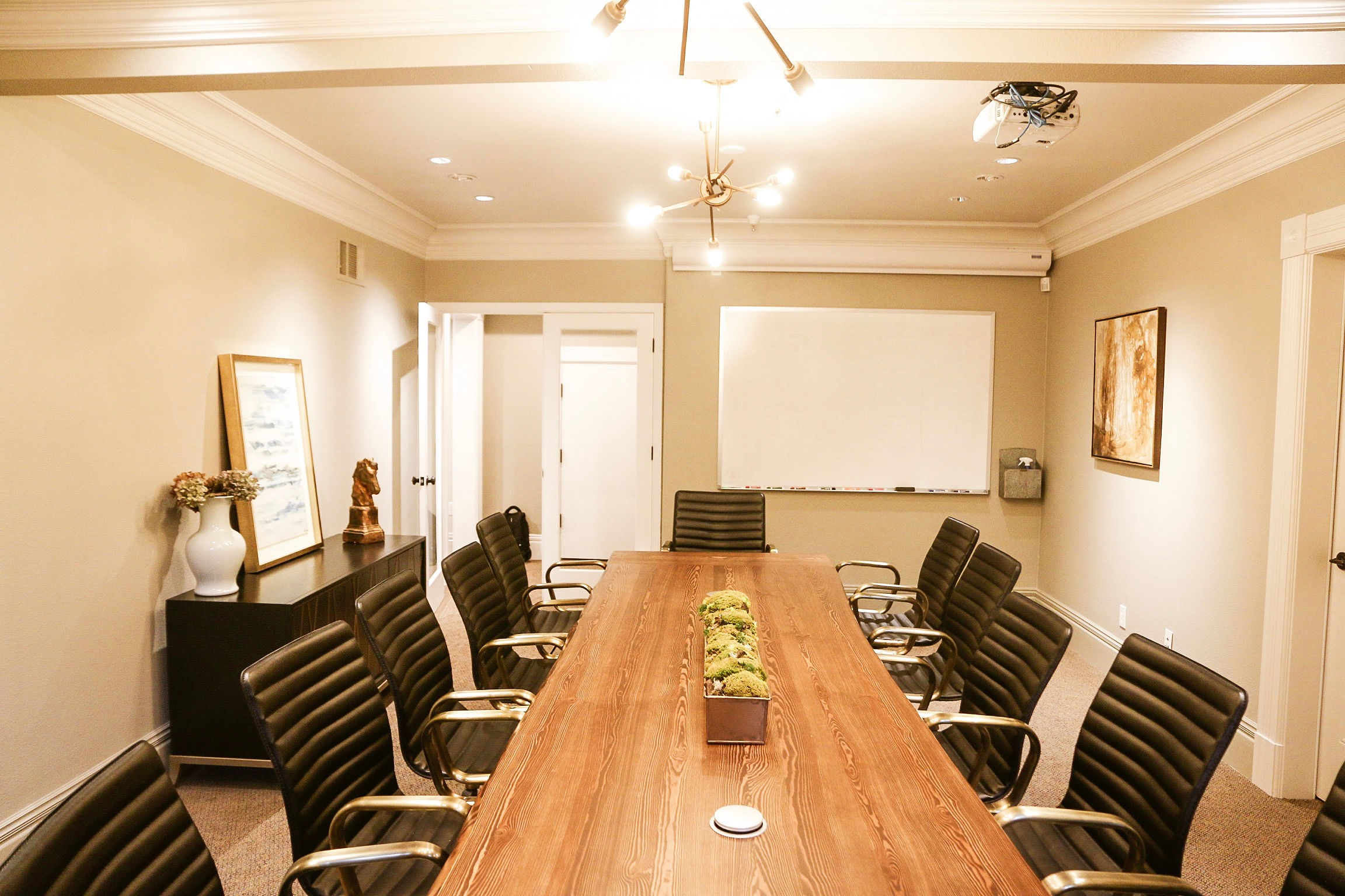 "The Boardroom - 12' Custom Live Edge Table + 12 Black & Brass Adjustable Leather Chairs + 65"" LCD w/AppleTV + Large Whiteboard + Projector for Presentations"