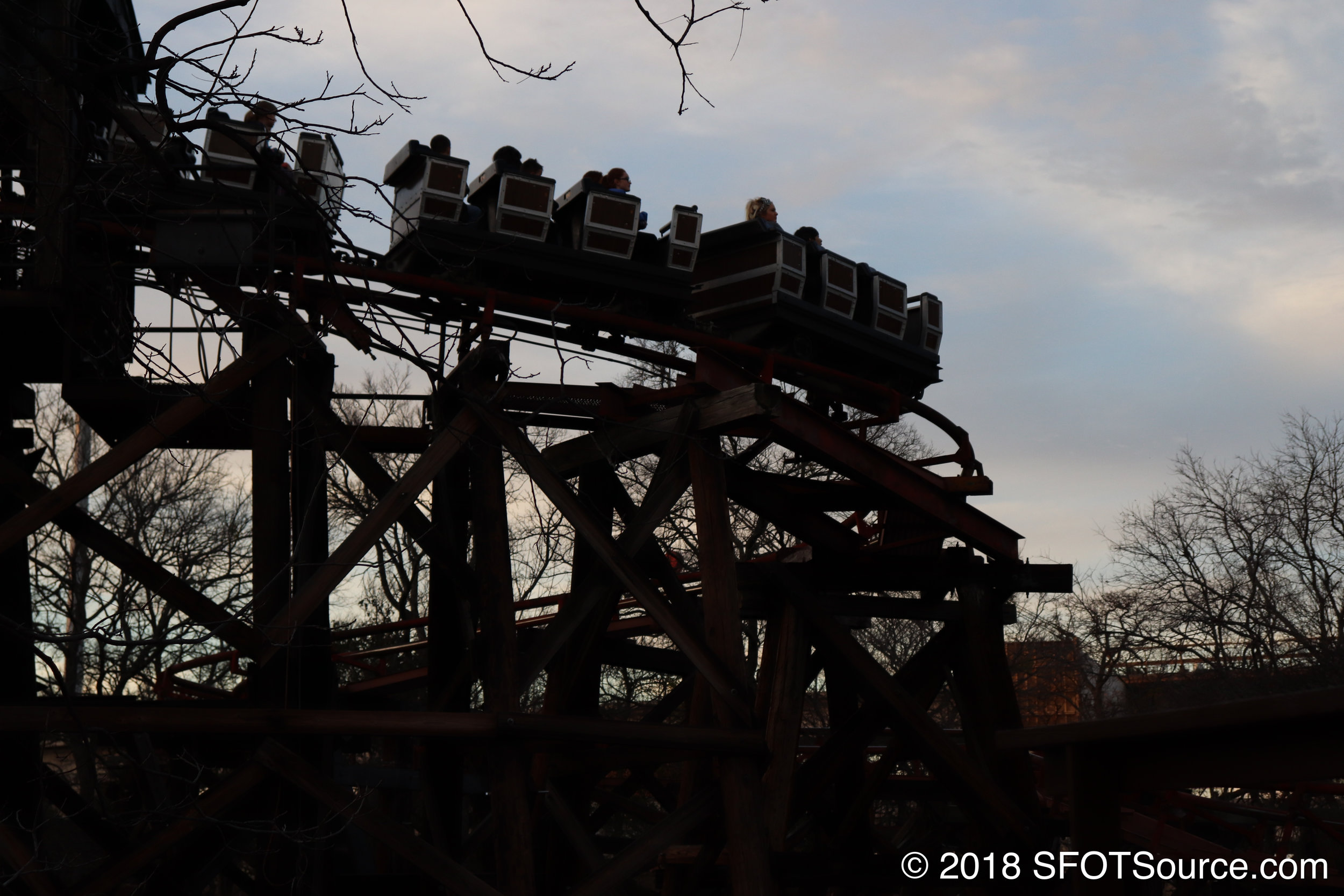 A train leaves the ride's first lift hill.
