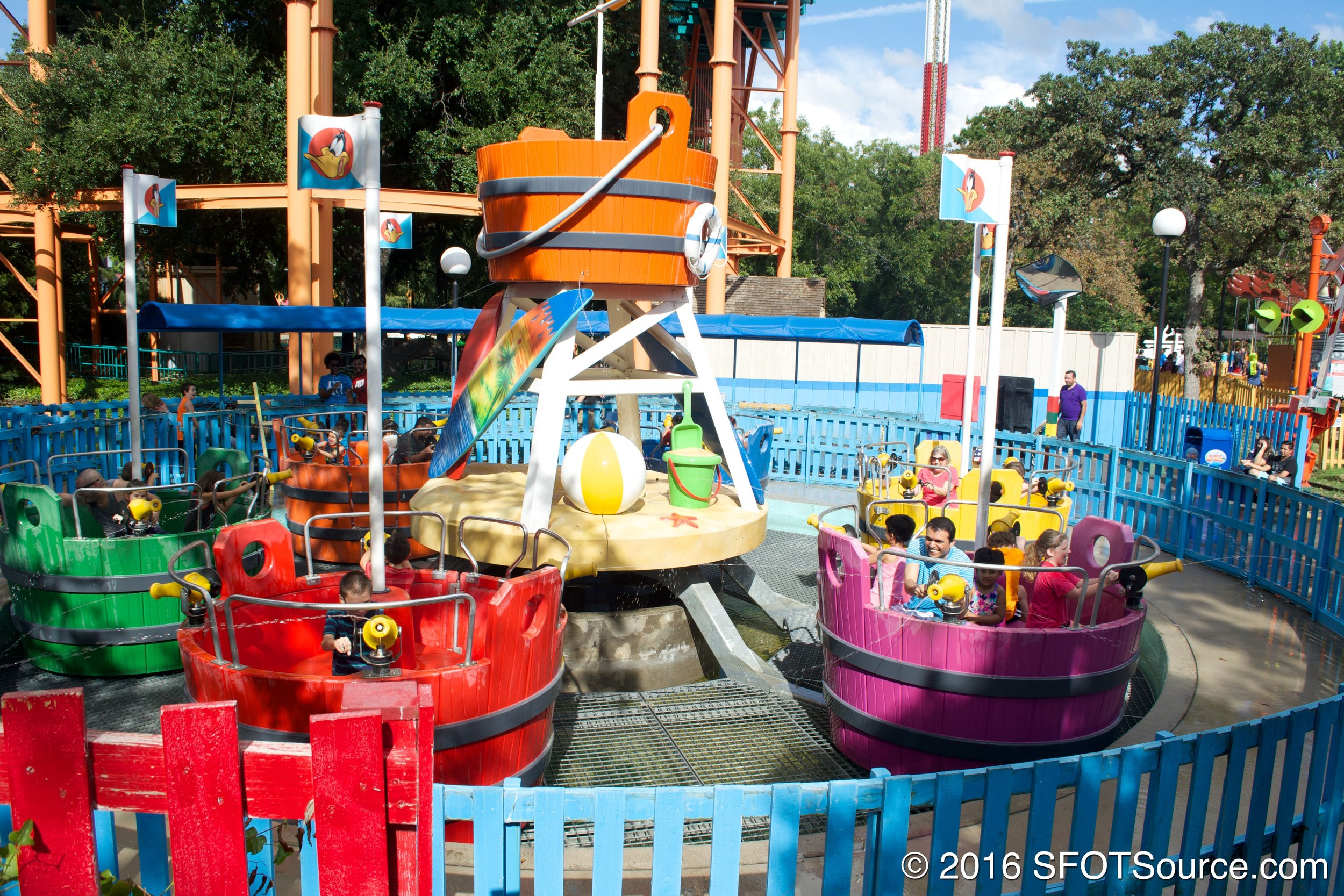 Guests use water blasters to spray each other.