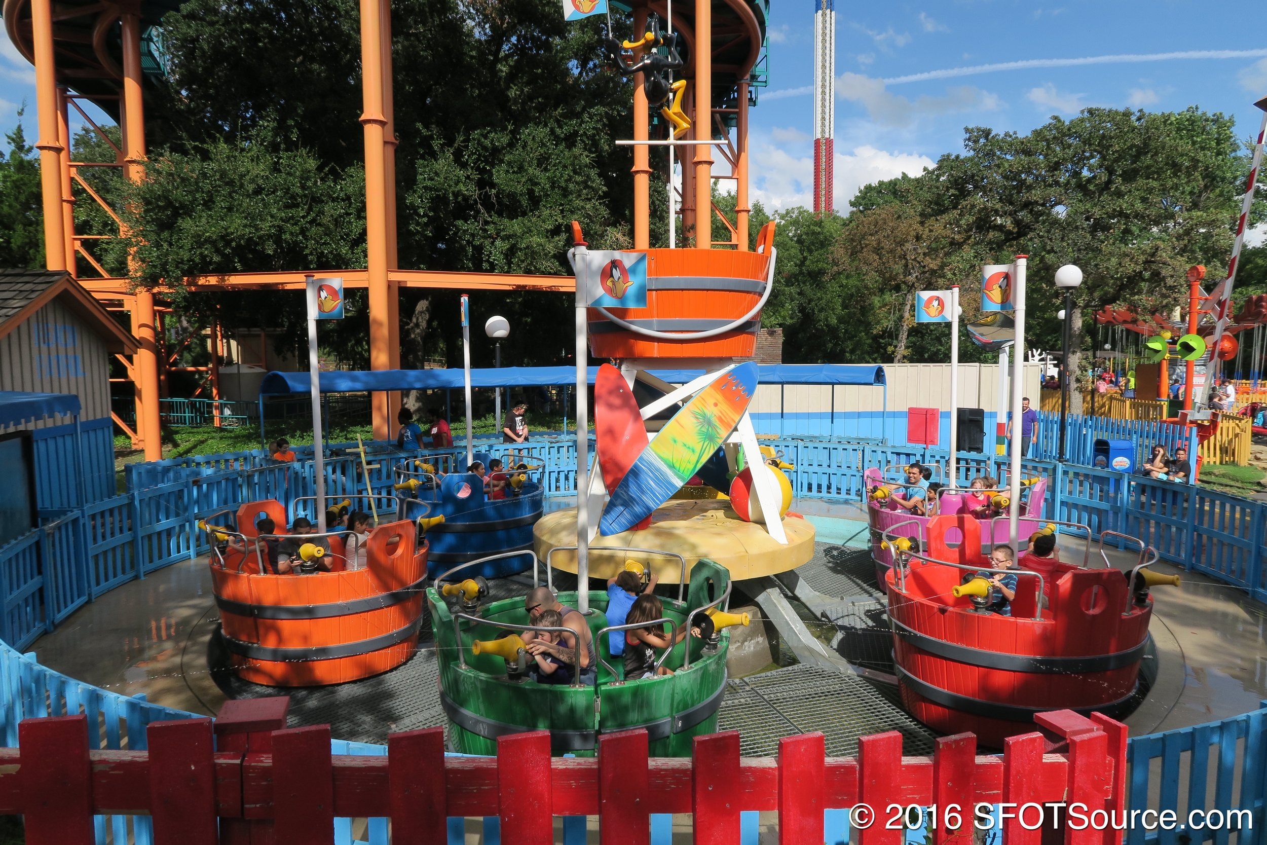 The ride spins while guests attempt to spray each other.