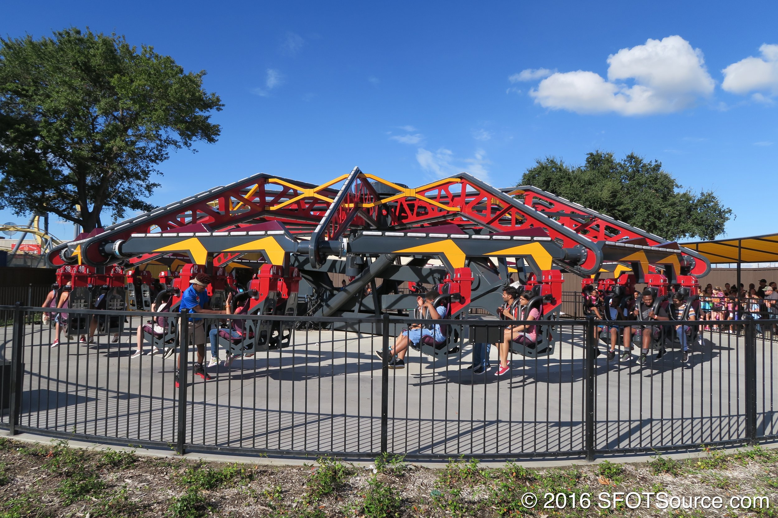 Riders await their turn on Catwoman Whip.