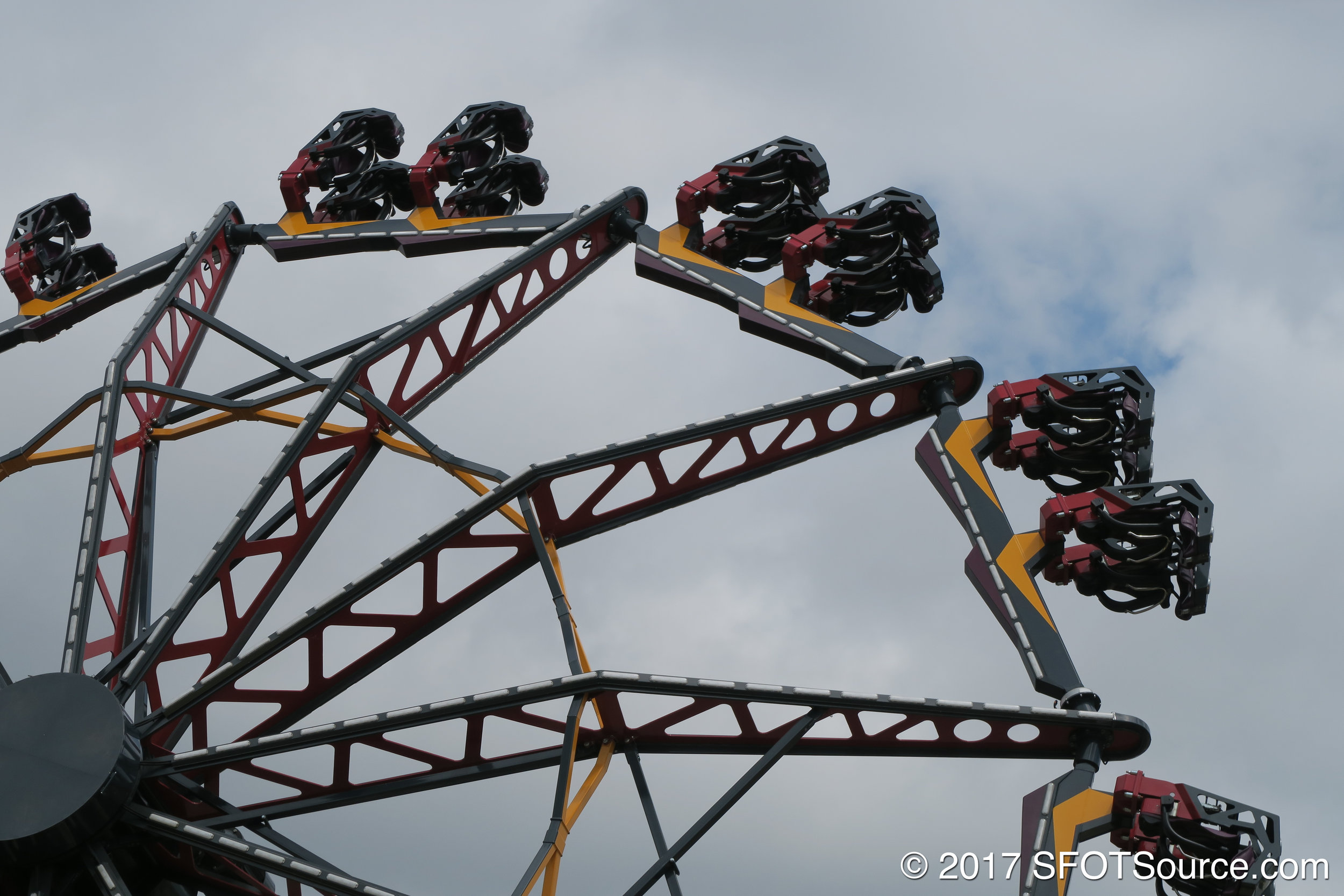 Riders sit two across in each row.