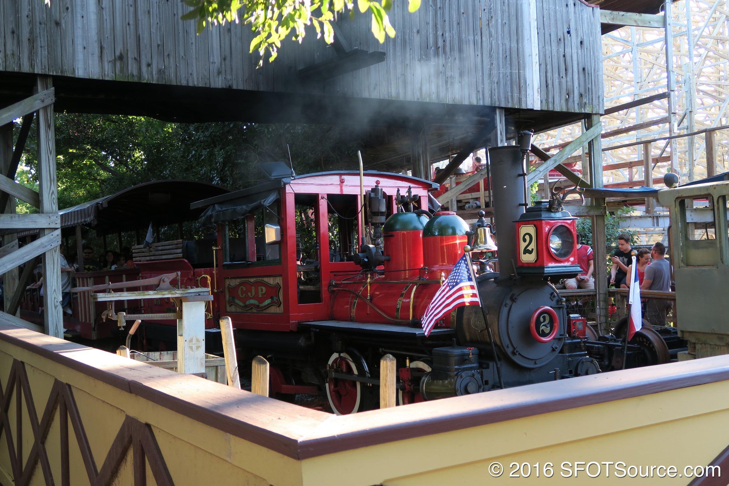 A train awaits passengers.