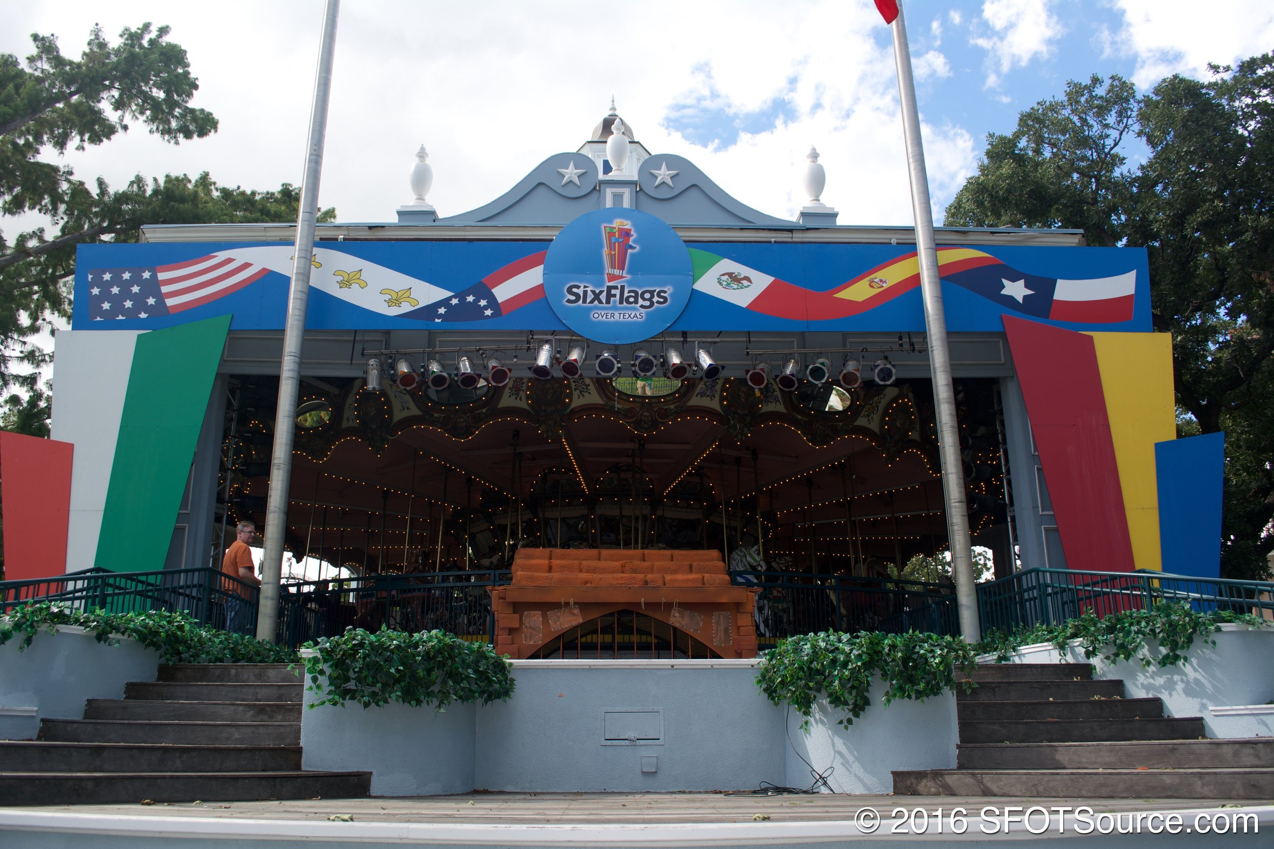 An outdoor stage located near the park's front gate.