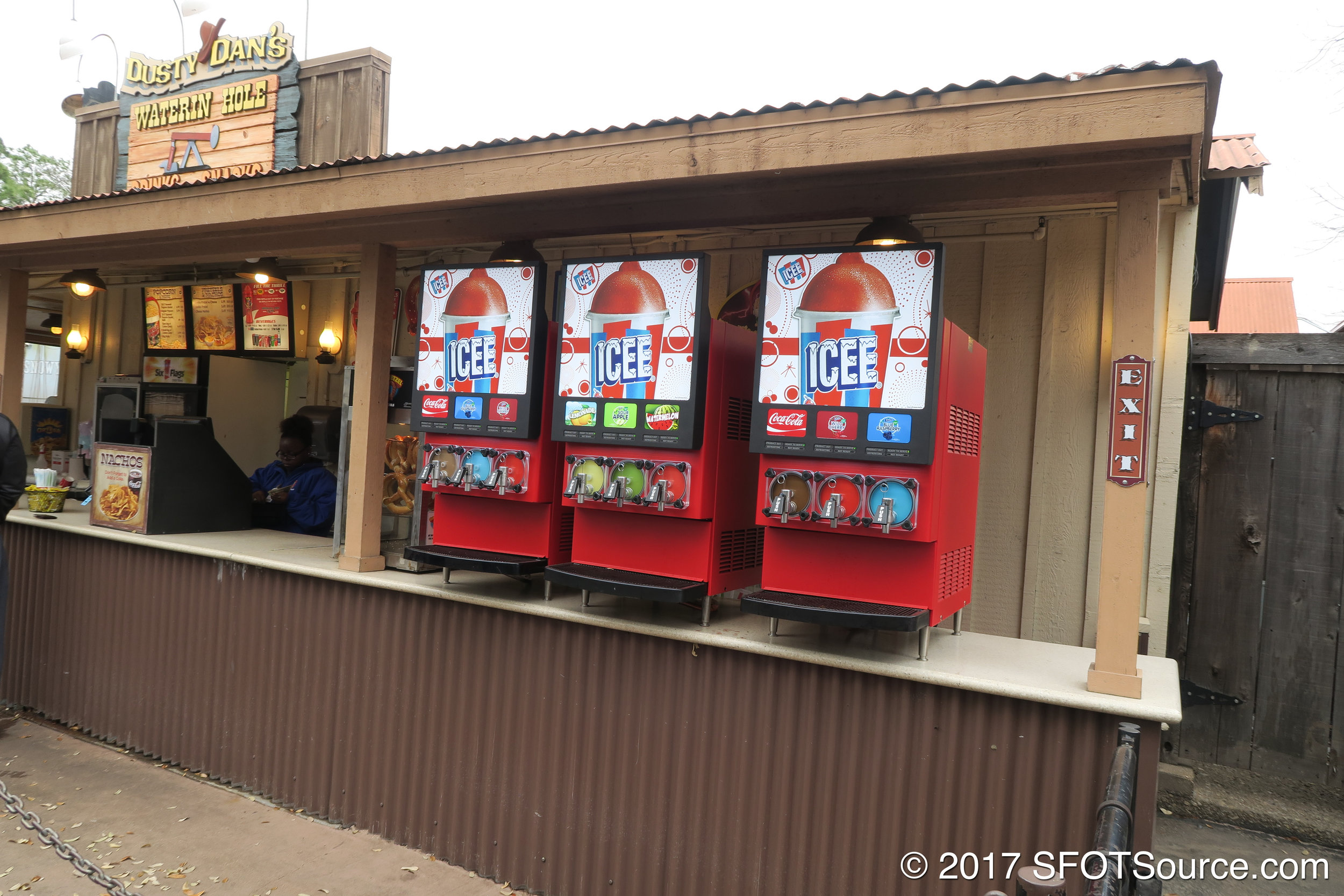 The stand features multiple frozen drink flavors.