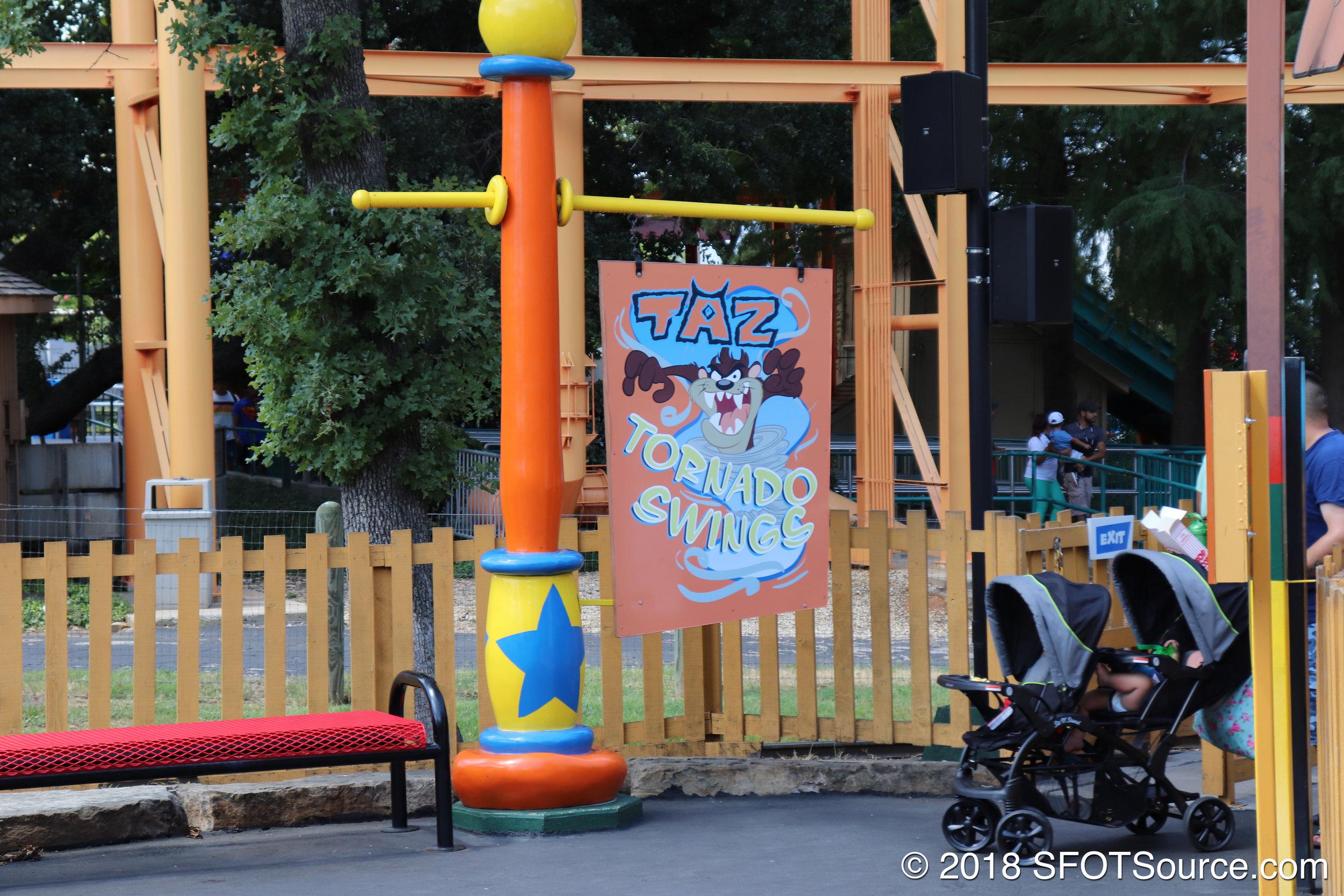 The main sign for Taz Tornado Swings.