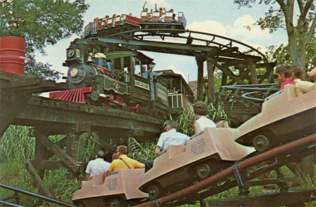 Mini Mine Train zooms under the Six Flags Railroad with Runaway Mine Train in the background. Credit: Six Flags Archives