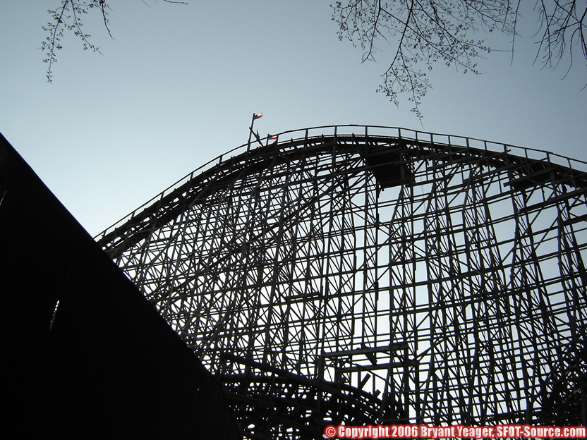 The sun sets on the first drop of The Texas Giant.