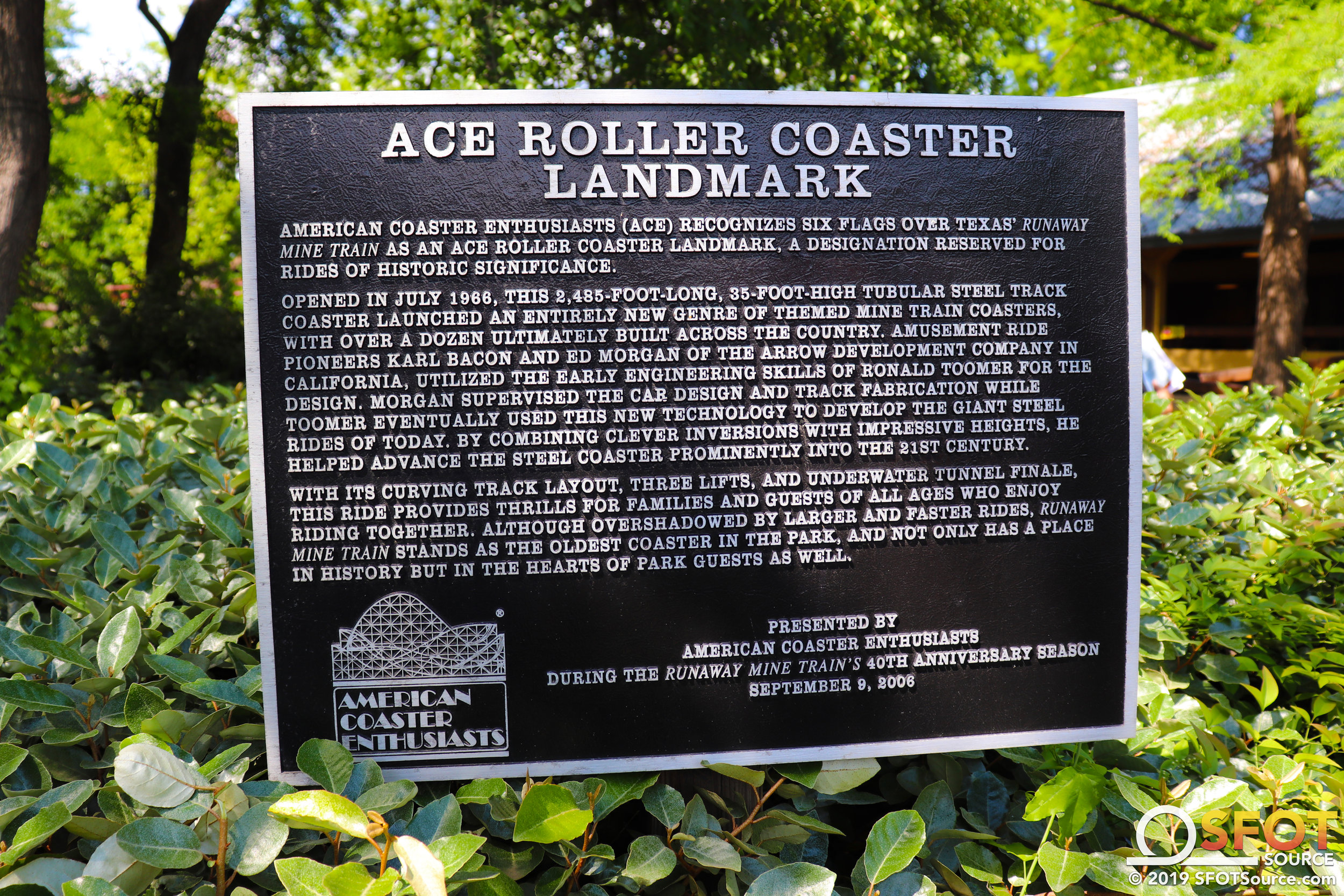 The ACE Roller Coaster Landmark plaque located at the entrance to Runaway Mine Train.