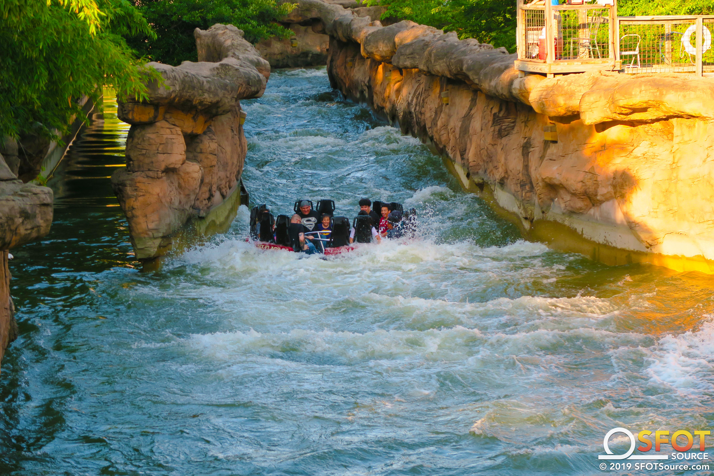 Passengers travel through the final huge rapid of the ride cycle.