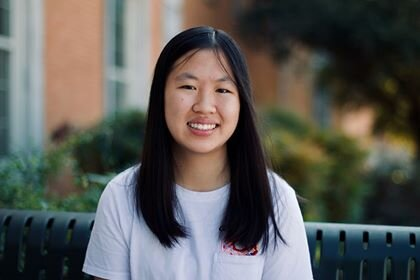 Grace Huang smiles on the bench in front of McConnell Hall. Photo taken by Raffer Li.