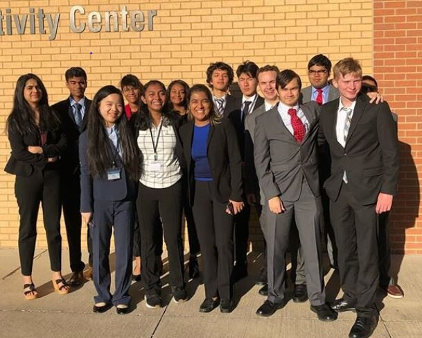 Apsara Mitra and other TAMSters pose at the Dallas Area Model United Nations competition. Photo from TAMS Ballot.