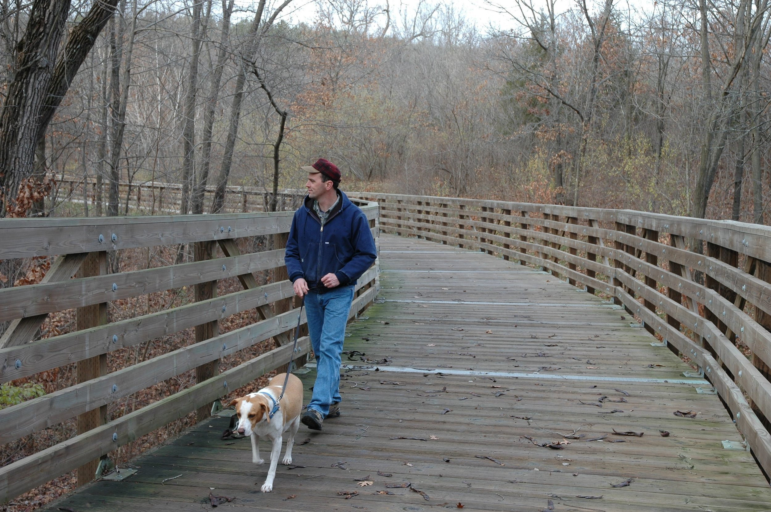 man with dog on trail bridge.jpg