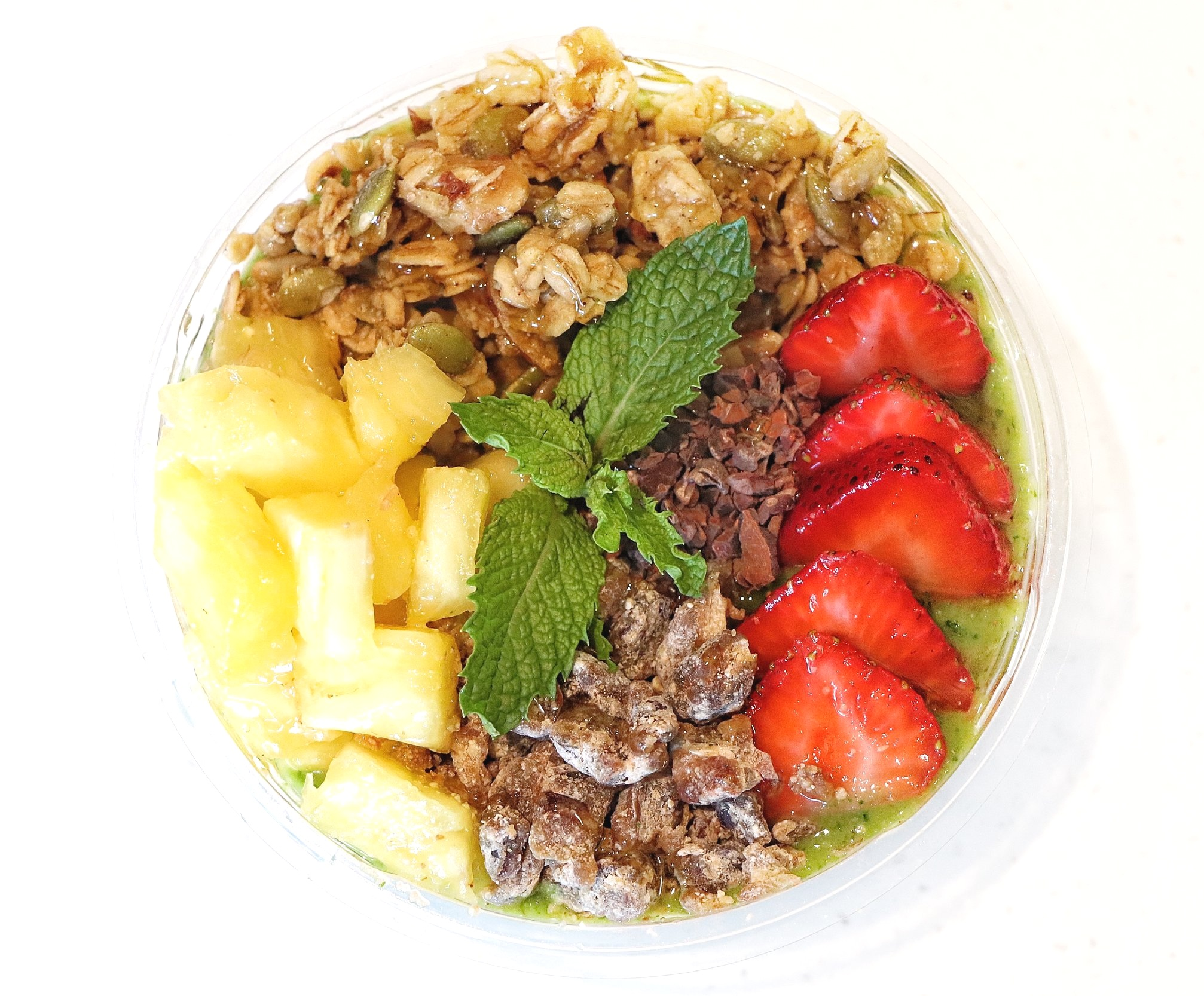 Matcha : Spinach / Kale / Banana / Mango / Matcha / Hemp Seed / Flax Seed / Coconut Water / Lime  Topped with Pineapple, Strawberry, Dates, Granola, Cocoa Nibs, Mint, Drizzle of Honey