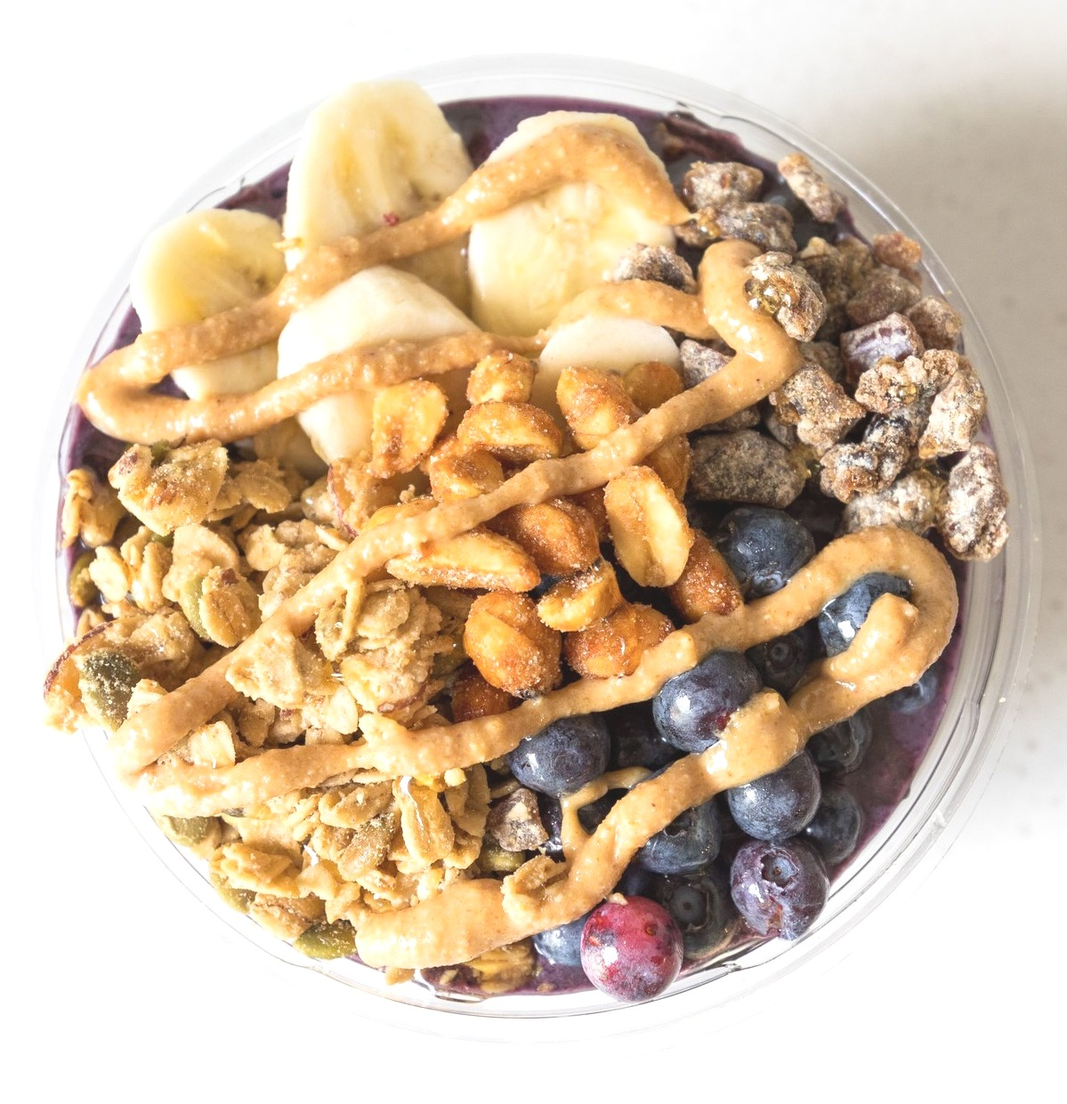PB + B Bowl:  Acai / Bananas / Blueberry / Peanut Butter / Dates / Almond Milk  Topped With Banana, Blueberry, Honey Roasted Peanut Butter Drizzle, Granola, Chopped Dates