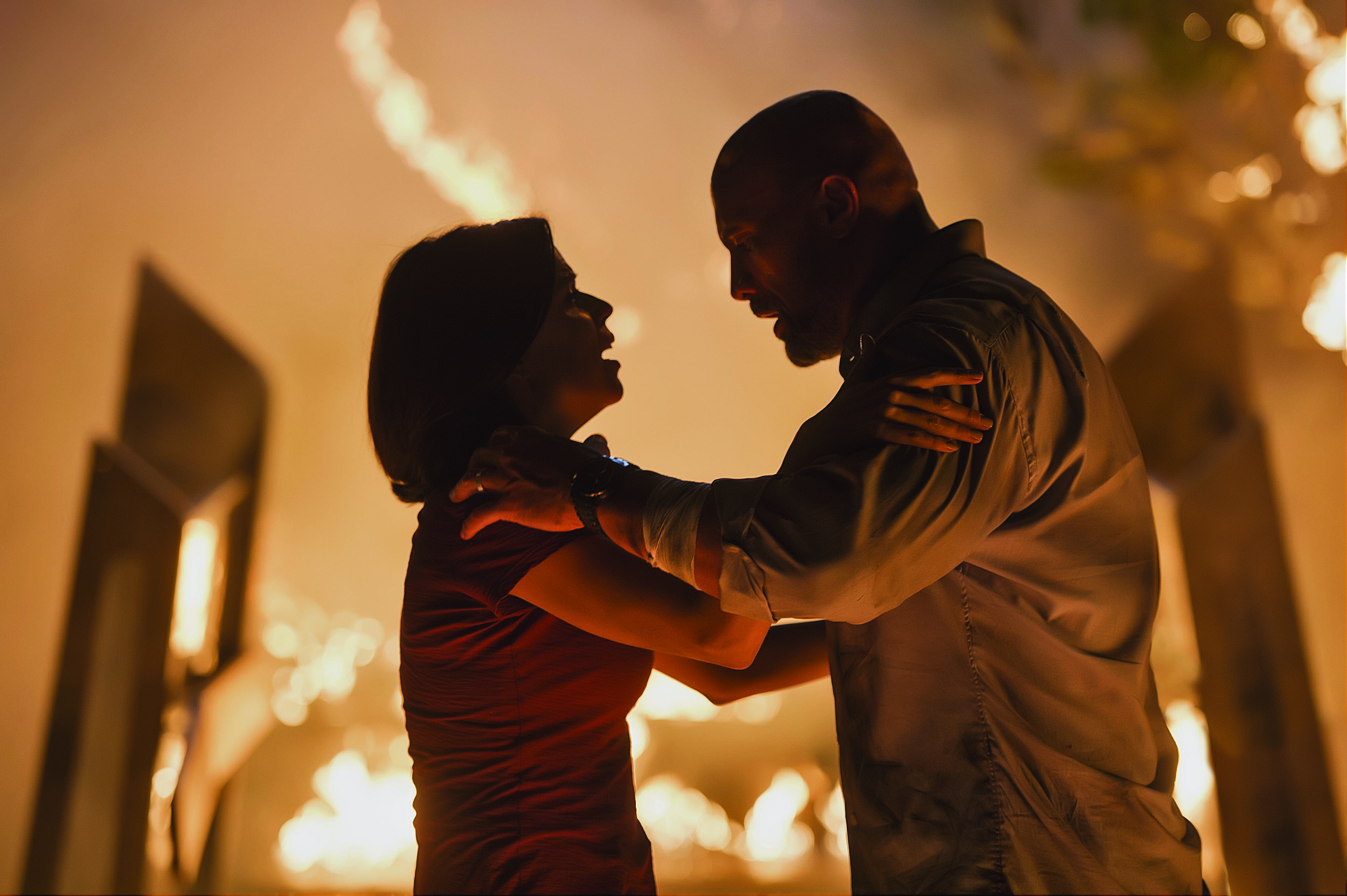 """Neve Campbell and Dwayne """"The Rock"""" Johnson in """"Skyscraper."""" (Photo courtesy Kimberley French/Legendary Pictures/Universal)"""