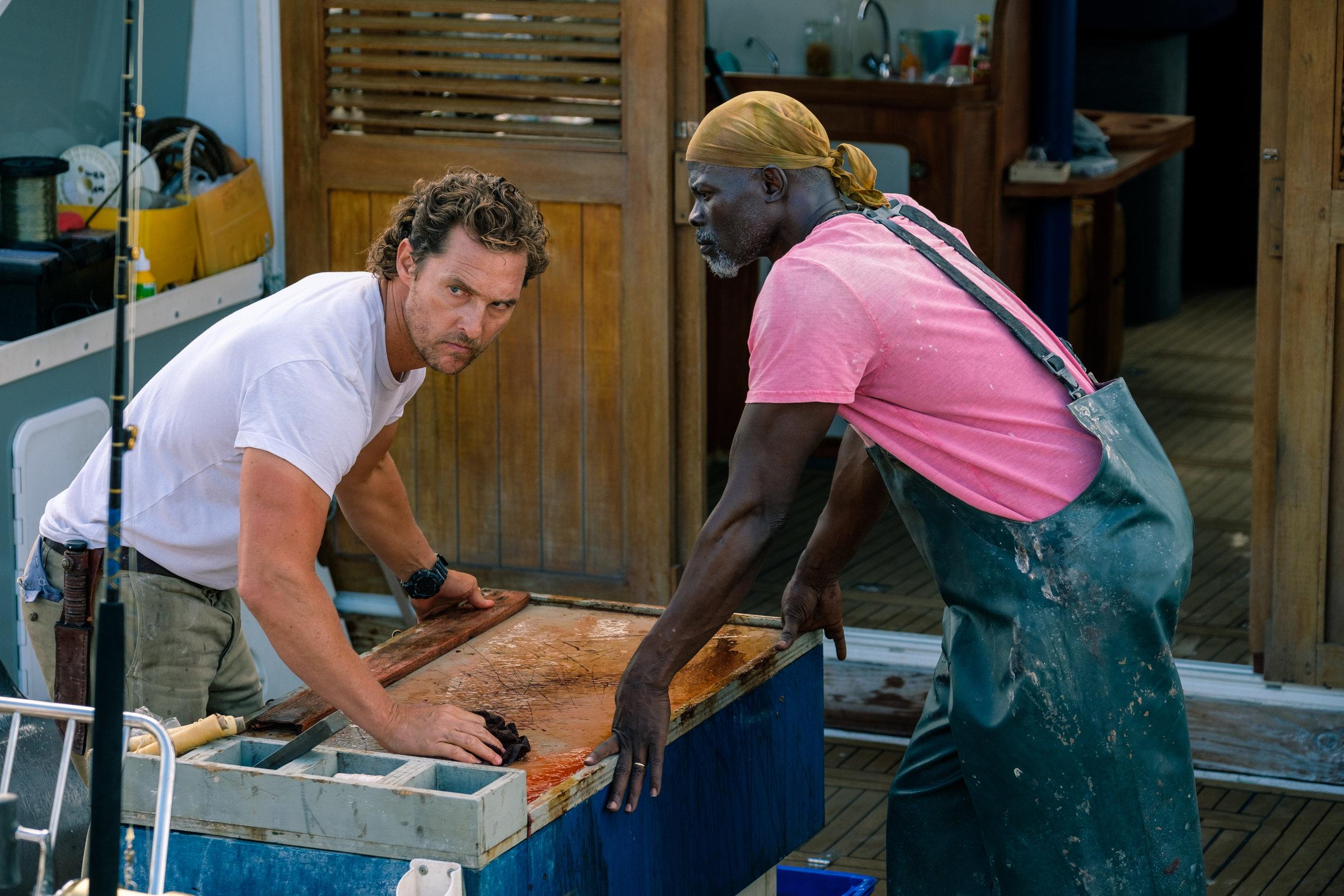 "Matthew McConaughey and Djimon Hounsou in ""Serenity."" (Photo courtesy Graham Bartholomew/Aviron Pictures)"