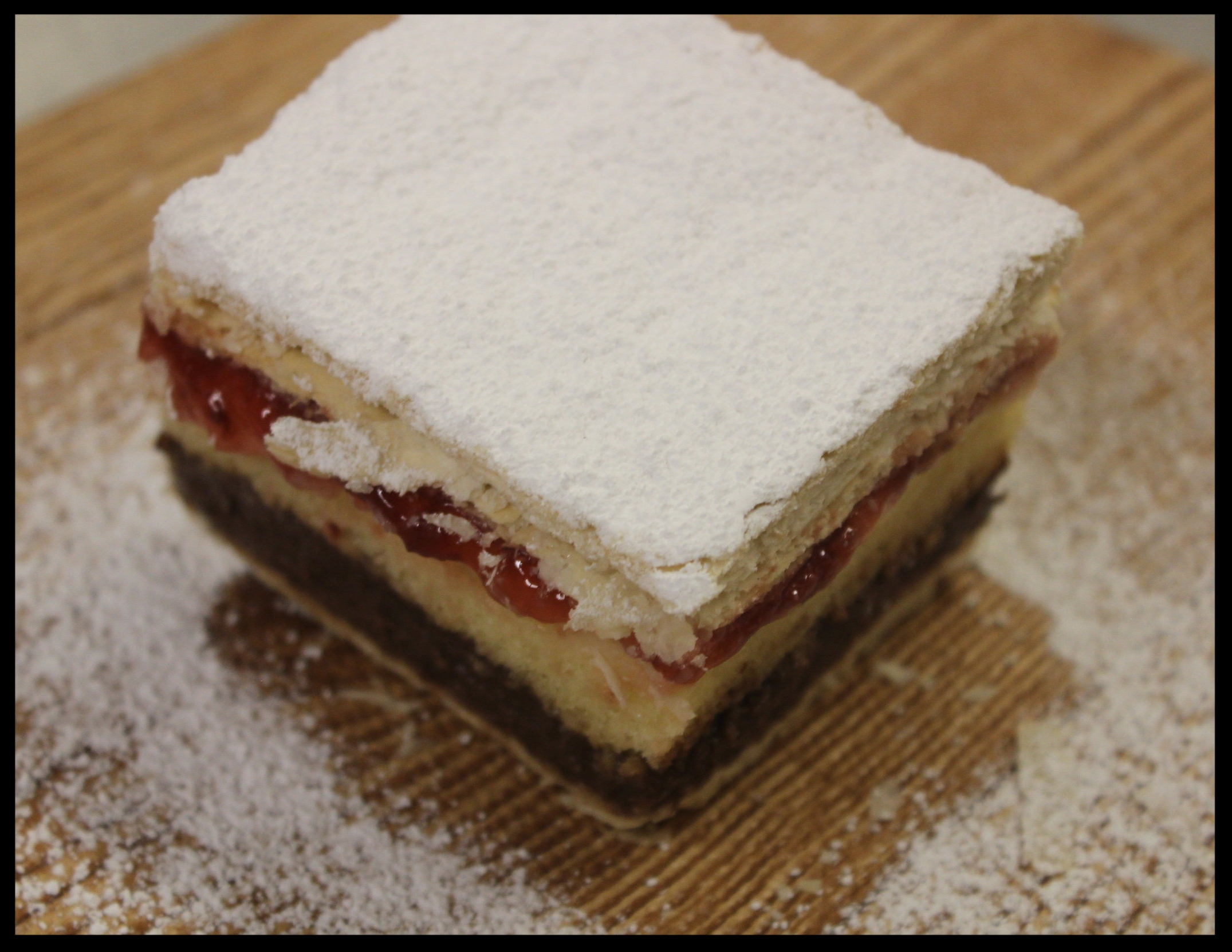 Rum Napolean - Rum soaked sponge cake with chocolate and vanilla cream and strawberries, in between puff pastry dough layers. Oh and powdered sugar all over the top.