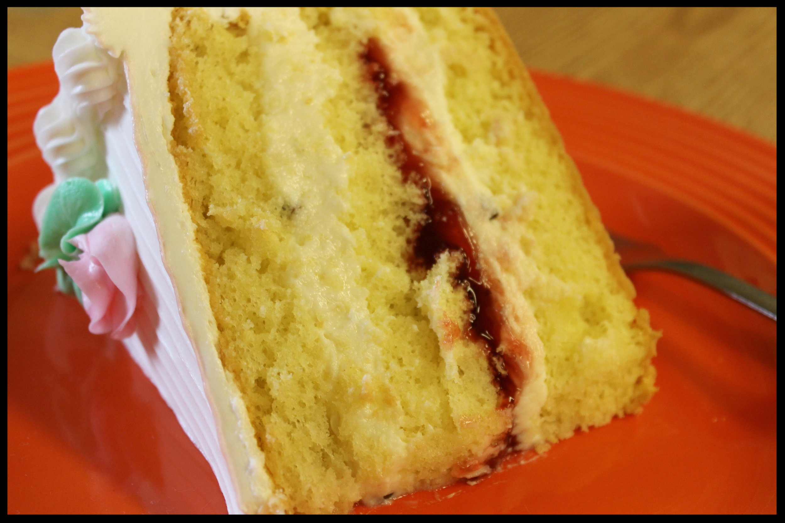Vanilla Cannoli Slice - Vanilla sponge cake with cannoli cheese and strawberry.
