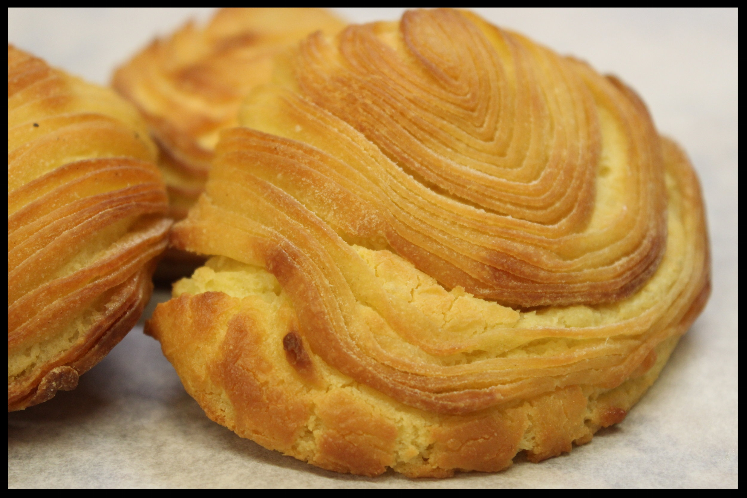 Sfogliatelle - A cheesy dough made with semolina and ricotta, wrapped in a crispy shell. Say it with me