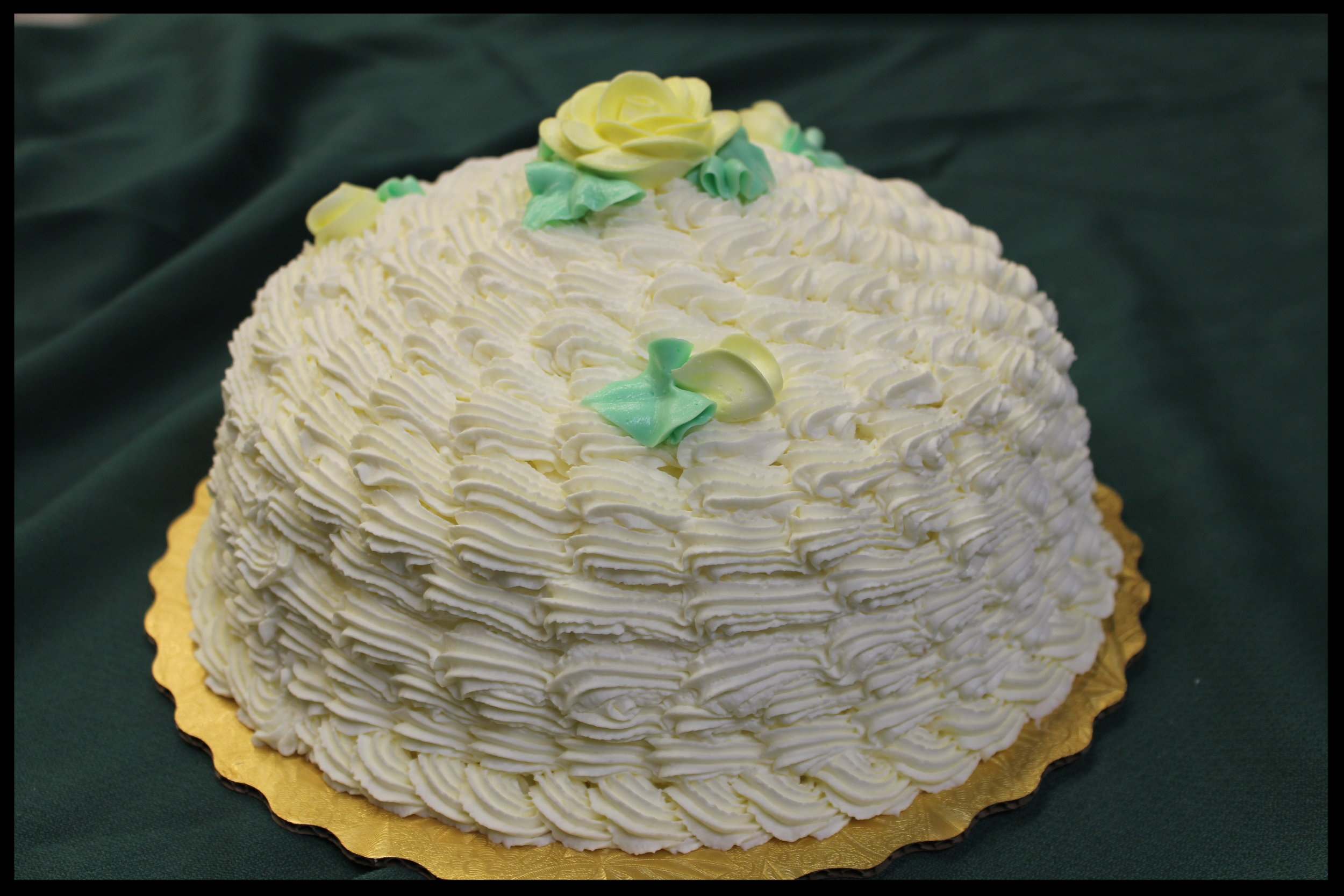 Zuppa Inglese - Vanilla or Rum sponge cake in a dome shape with extra fillings and whipped cream frosting. In Italian it means
