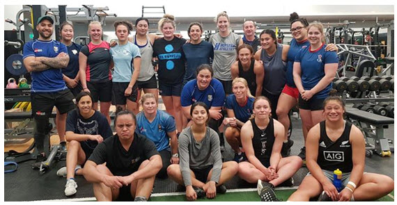 Image: Slade King (left) balances study, a family and coaches athletes including the BOP Volcanix women's rugby team.
