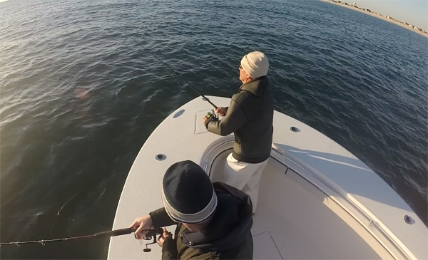 Co-owner, Bob Nugent, angling on the bow. Photo courtesy of JustBeneaththeSurfaceNJ.com