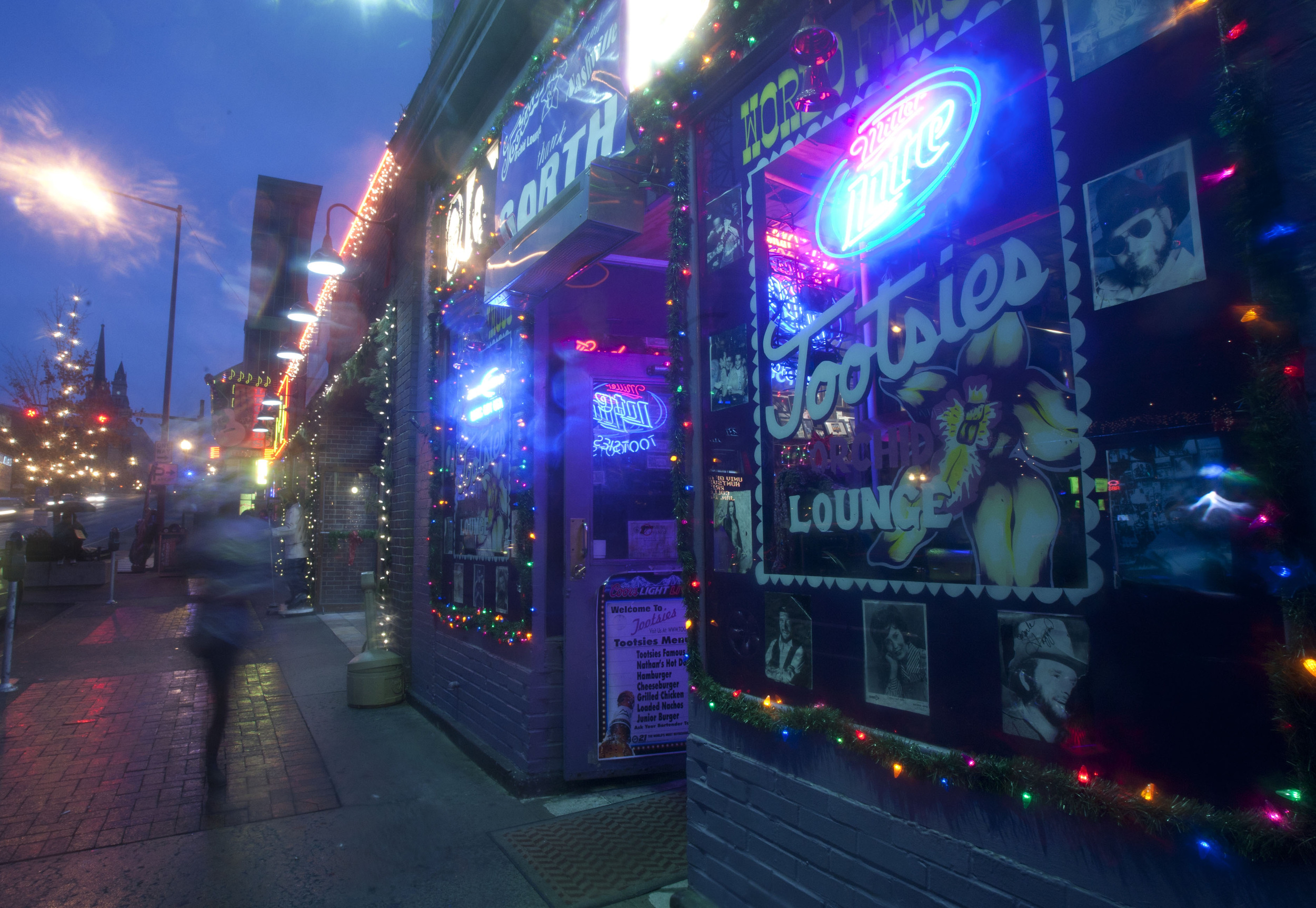 Sleet falls on a chilly Christmas Eve outside famed honky tonk, Tootsie's Orchid Lounge,  in downtown Nashville, Tenn.