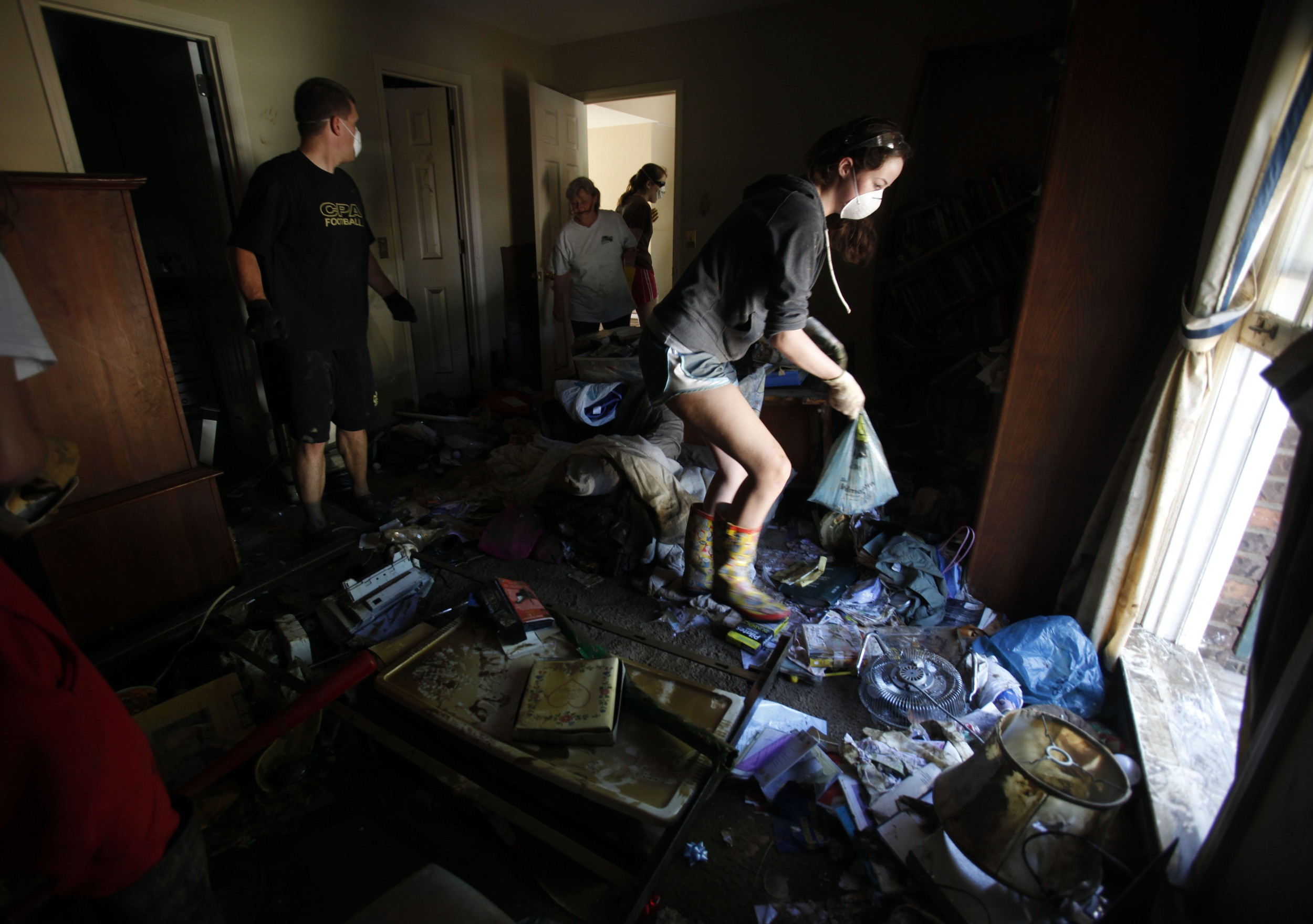 Elizabeth Patton, 15, cleans out her flooded room with help from her friends and her mother on Beech Bend Drive Tuesday, May 4, 2010 in Nashville, Tenn.