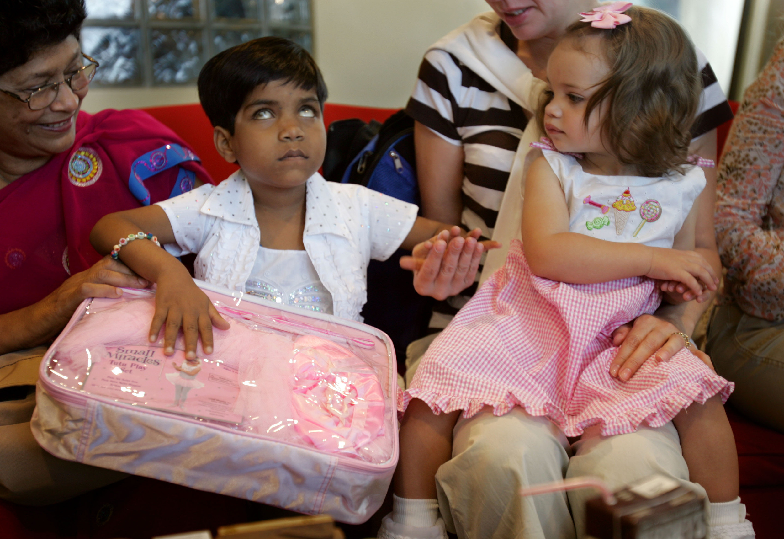 One-year-old Lexi Quillin, reacts shyly to an inquisitive Kajal,  during a party held for Kajal at the Wang Institute Friday, March 30 2007 in Nashville, Tenn.