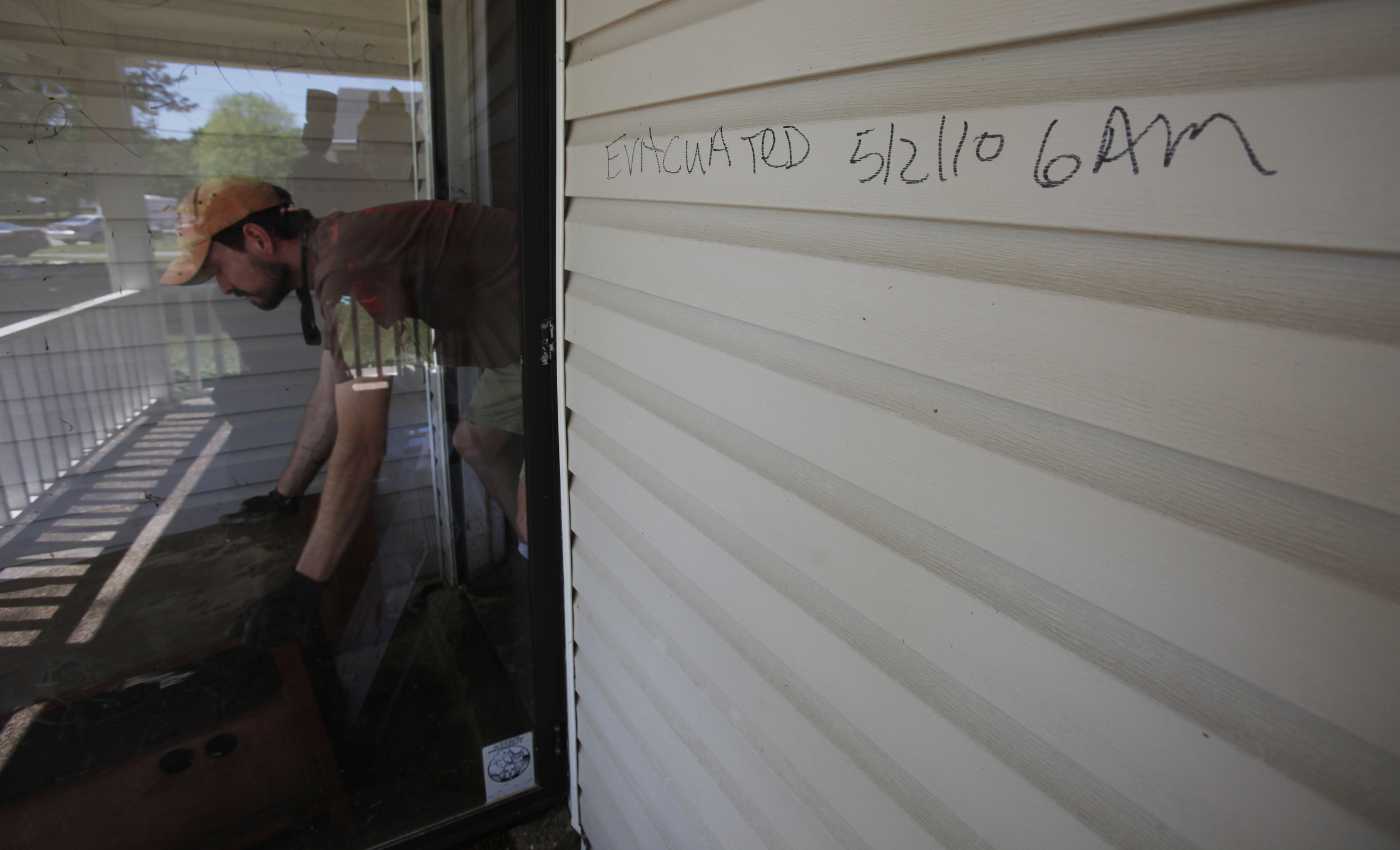 A doorway marked with evacuation notes as cleanup and recovery get started May 4, 2010 in the Bellevue area.