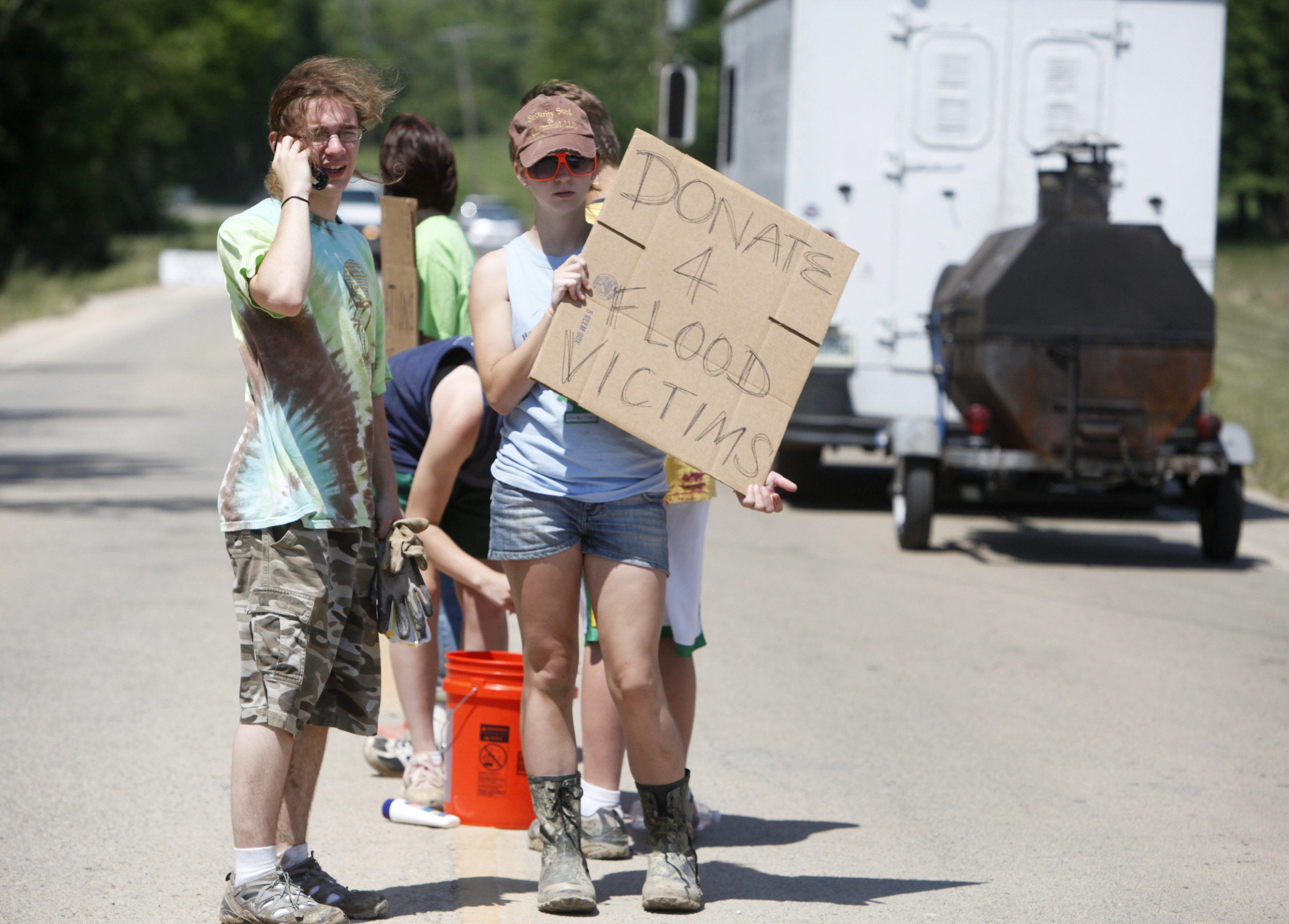 Students from Harpeth Middle School and High School stand in the middle of highway 70 soliciting donations for flood victims May 7, 2010 in Shacklett, Tenn.