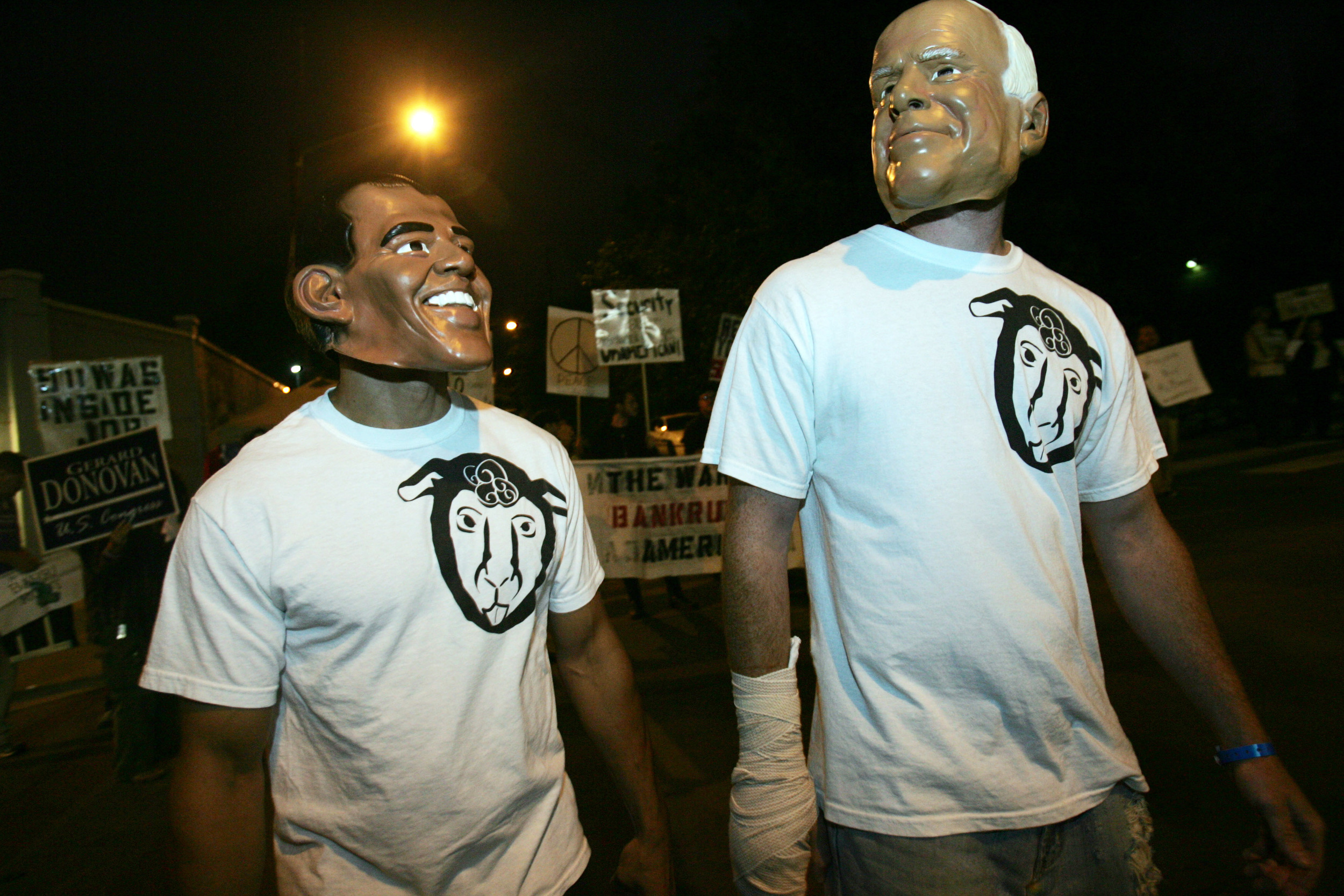 A group protesting the lack of third party candidates wears Obama and McCain masks outside the town hall debate.