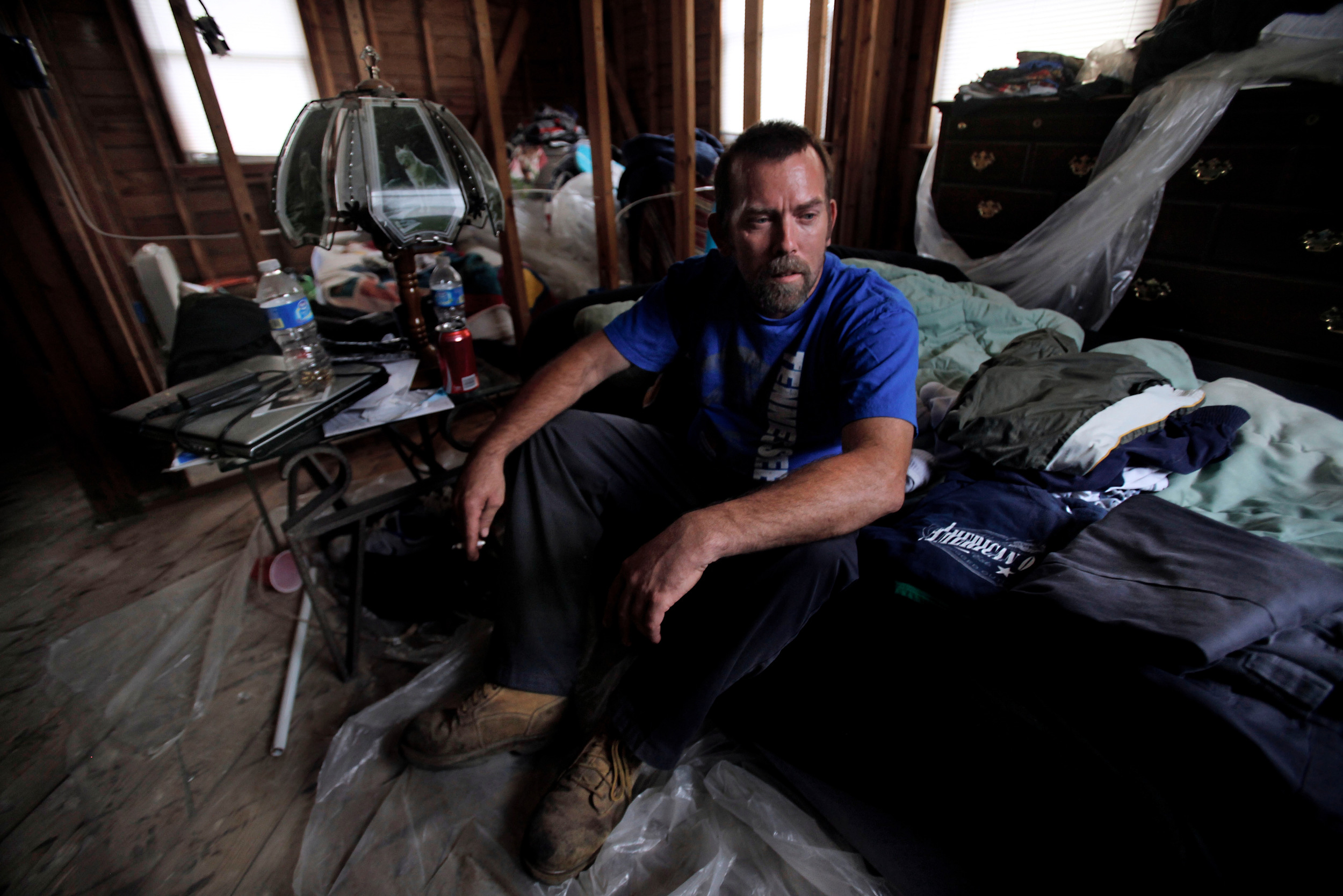 "Gregory Proctor has been living in the gutted remains of his house on an air mattresses six months after the flood in Nashville, Tenn. Proctor said he has been struggling to get his house rebuilt and has nowhere else to go. He received $1500.00 from FEMA and wonders why flood relief hasn't reached him. ""It's hard to come back from a long day of work to this,"" Proctor said."