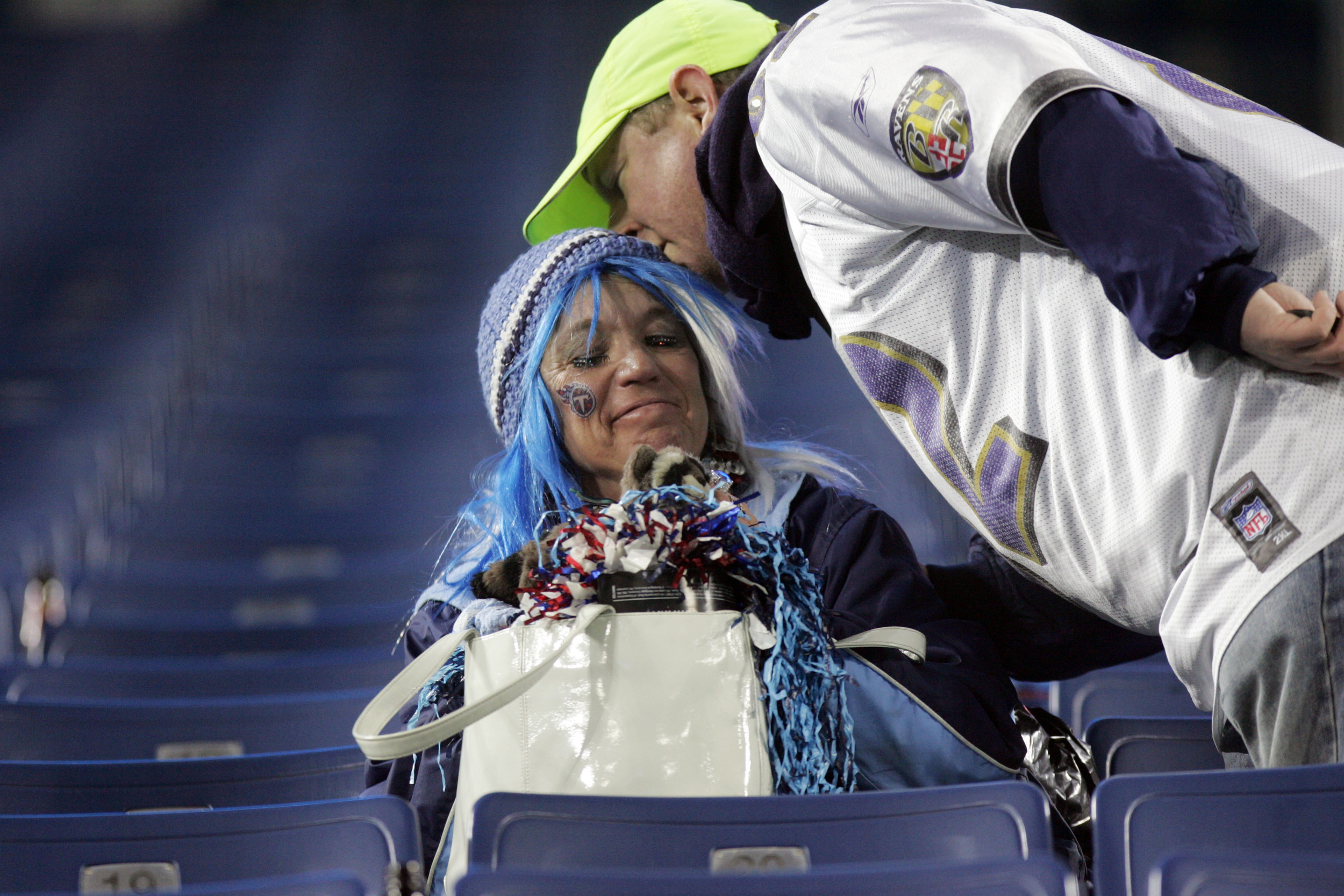 Titans fan Helen Locke gets a consolation kiss from a Ravens fan as she sat depressed in the stands after the Ravens defeated the Titans in the playoffs, smashing hopes of a Titans Superbowl at LP Field Saturday, January 10, 2009 in Nashville, Tenn.