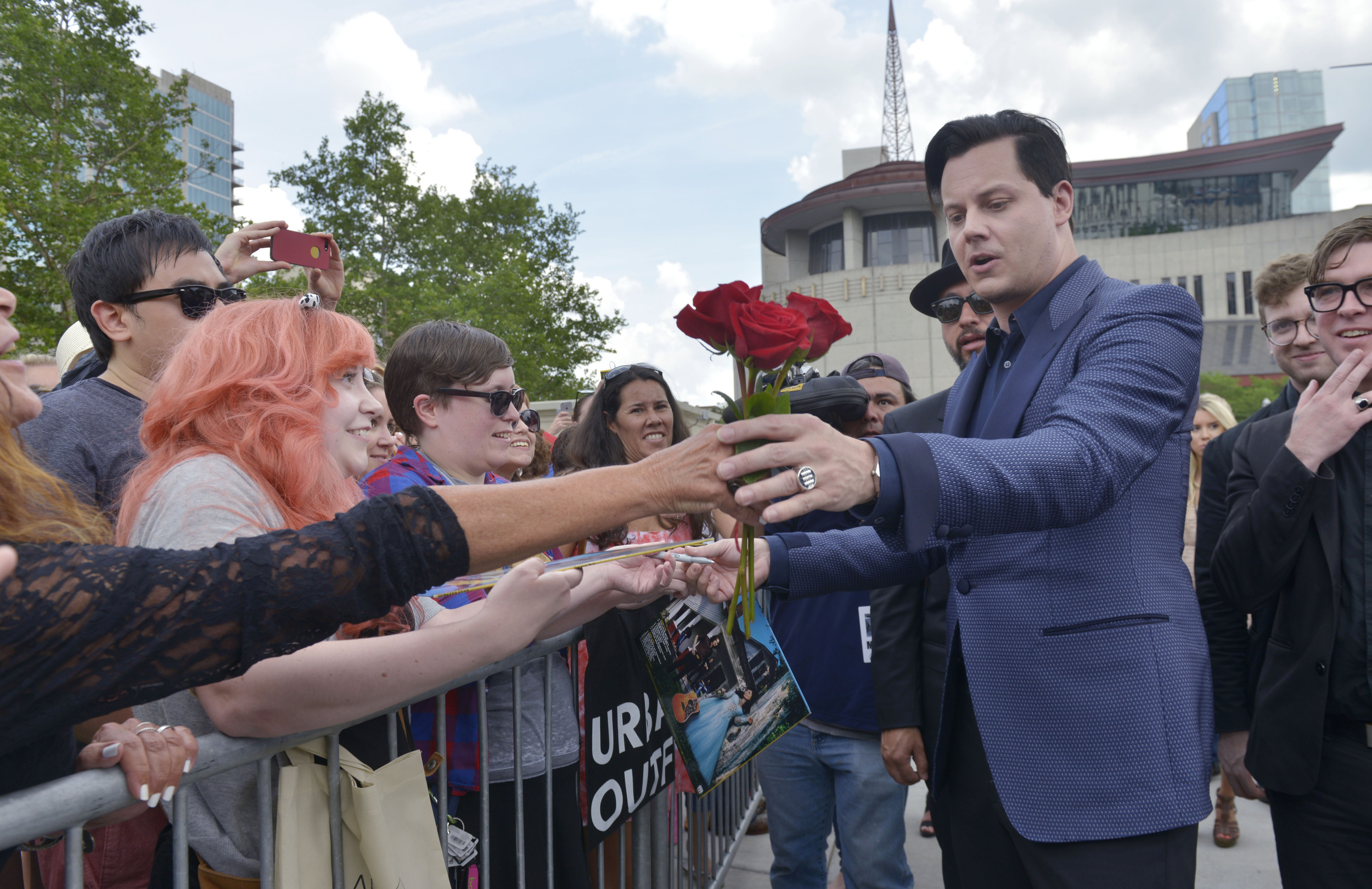 Jack White accepts a rose from a fan after being inducted with Loretta Lynn to the Music City Walk of Fame June 4 2015 in Nashville, Tenn.