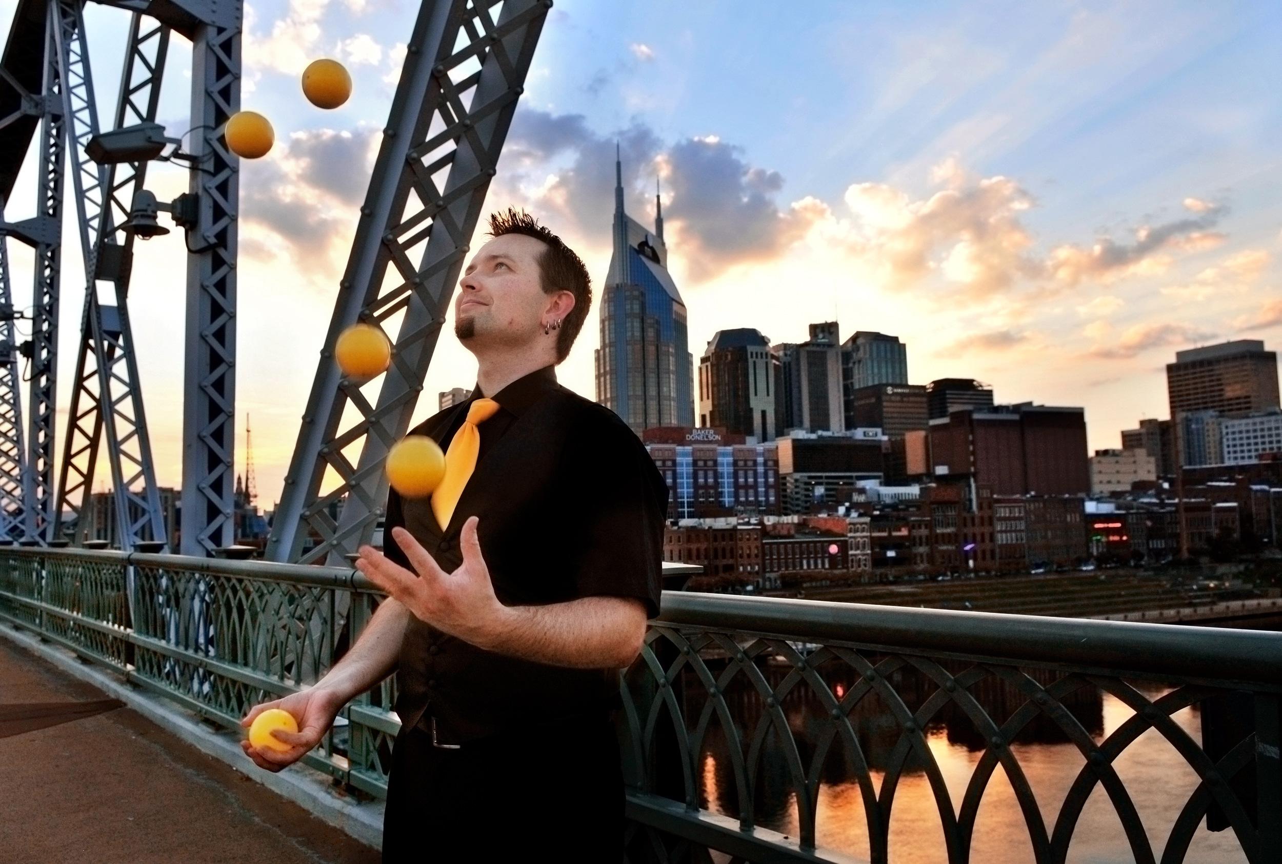 Ted Joblin juggles on the Shelby Street Pedestrian Bridge in Nashville, Tenn.