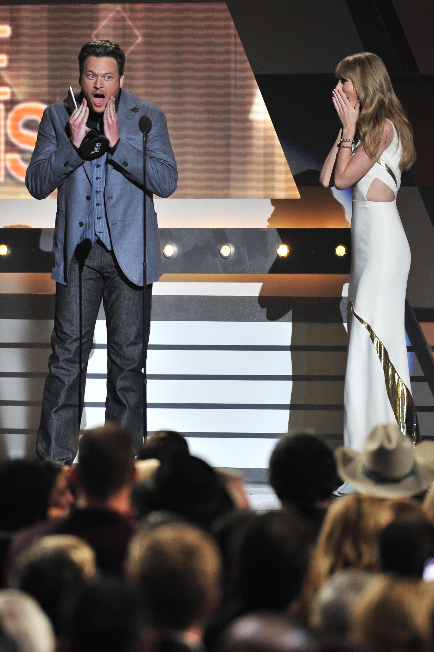 Blake Shelton jokes with Taylor Swift, imitating her noted look of surprise at awards shows, after winning Male Vocalist at the ACM Awards at the MGM Grand April 1, 2012 in Las Vegas, Nev.