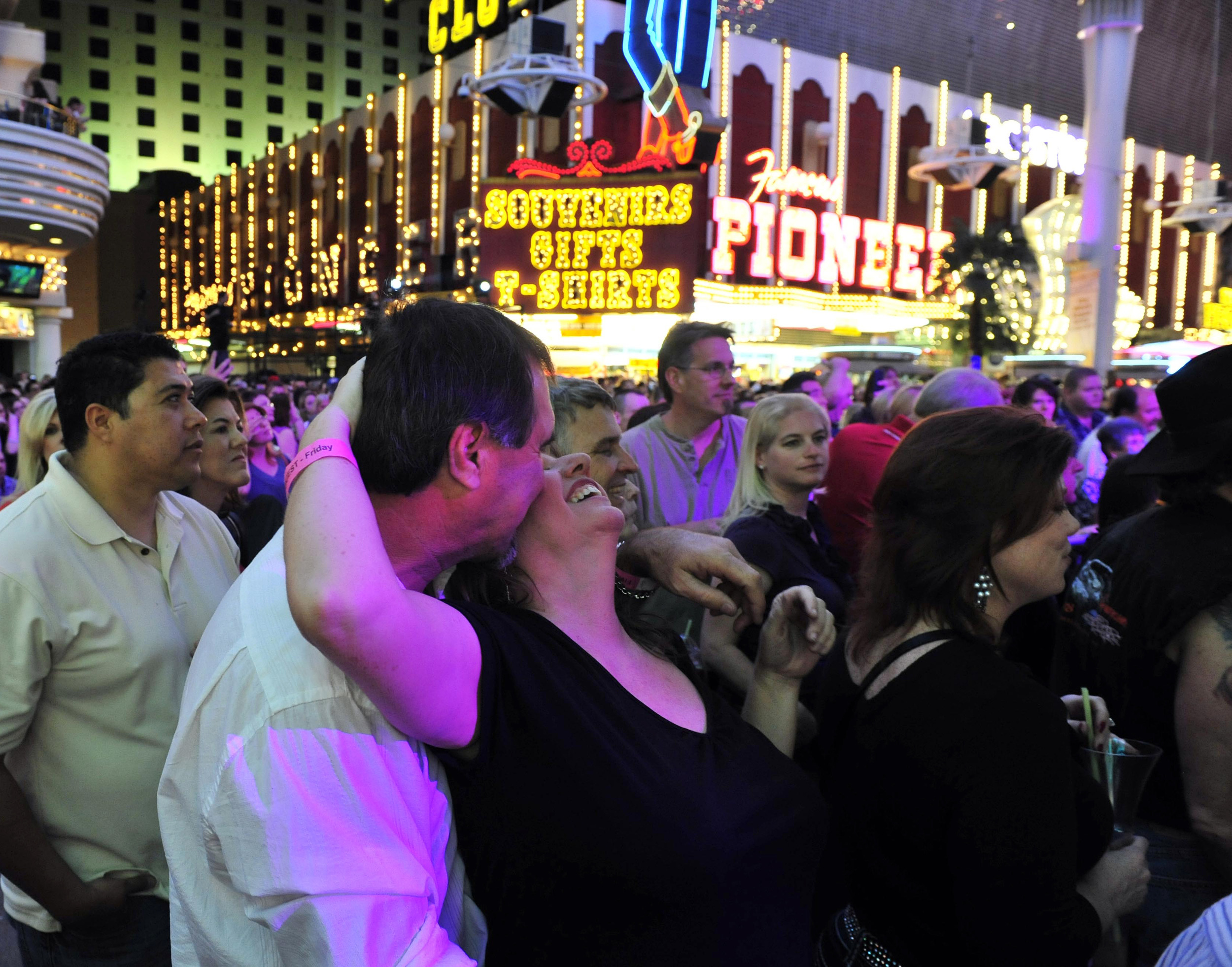 A couple dances and kisses while watching Scotty McCreery perform during ACM week March 30, 2012 in Las Vegas, Nev.