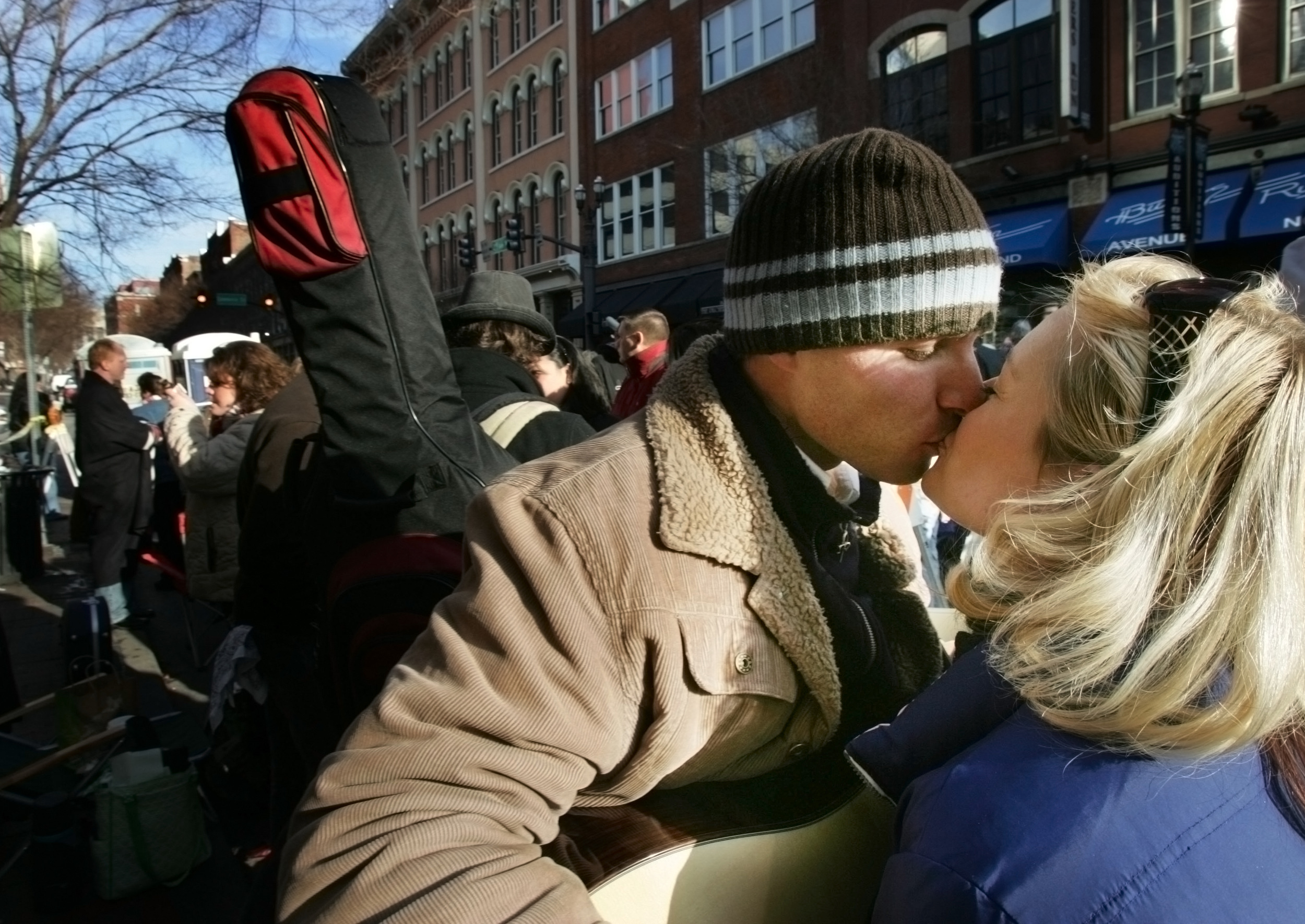 Singing partners Keesha Scott of Los Angeles, and Erik DiNardo of Boston share a friendly kiss as they wait in line downtown to audition for Can You Duet, a new talent show from American Idol producers Saturday, January 12, 2008 in Nashville, Tenn. T