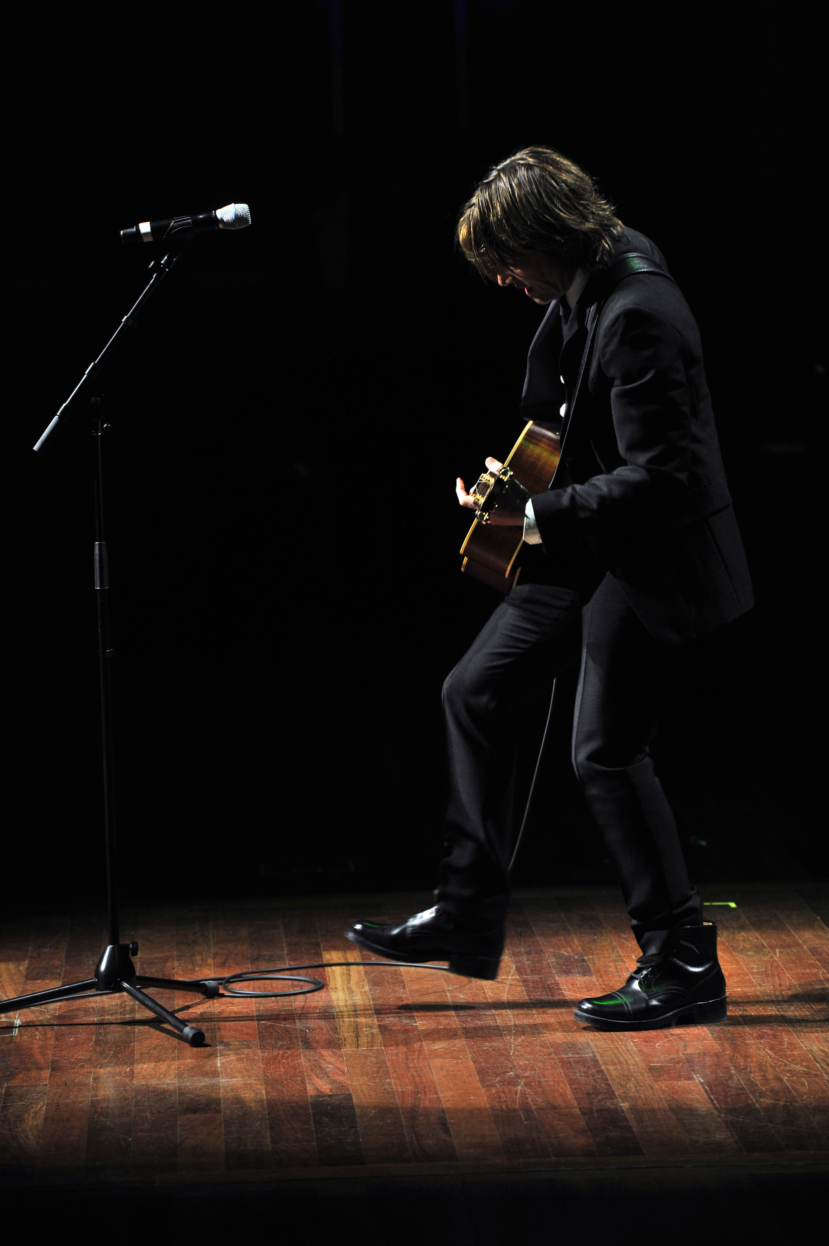 Keith Urban performs solo with an acoustic guitar at the Symphony Ball held at the Schermerhorn Symphony Center December 8, 2012 in Nashville, Tenn. .