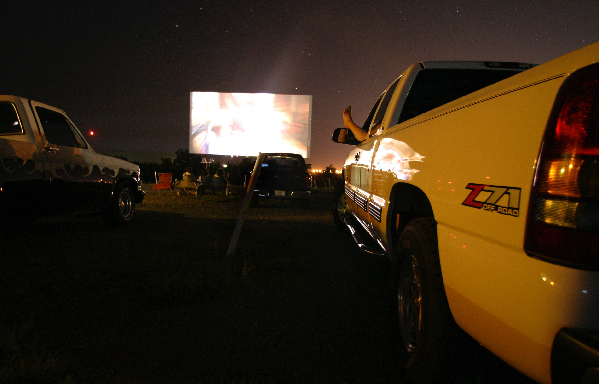 A foot sticks out of the window at the crowded drive-in theater in Weatherford, Oklahoma.