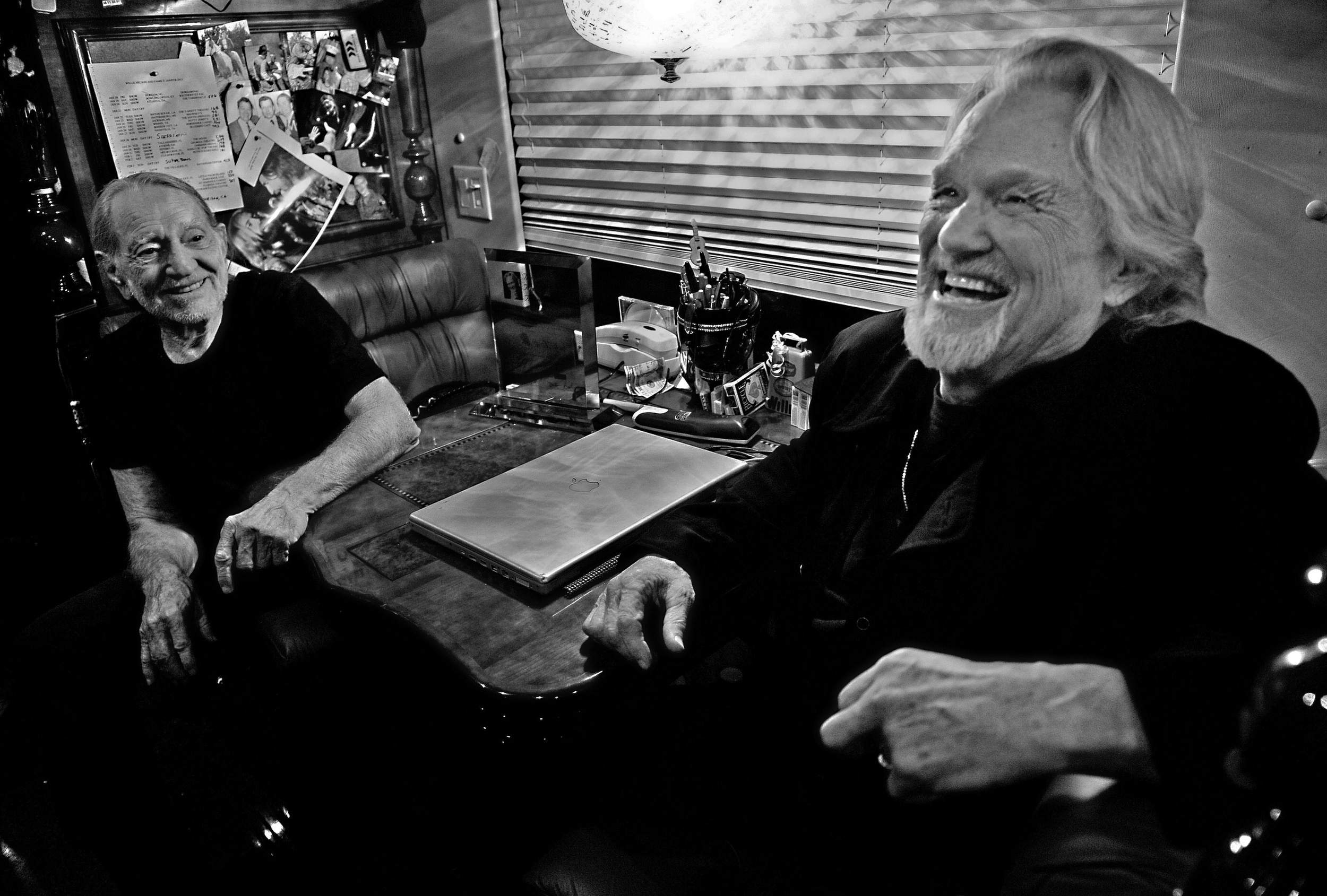 Willie Nelson and Kris Kristofferson share a joke together on the tour bus after performing at the Bluebird Cafe in Nashville, Tenn.