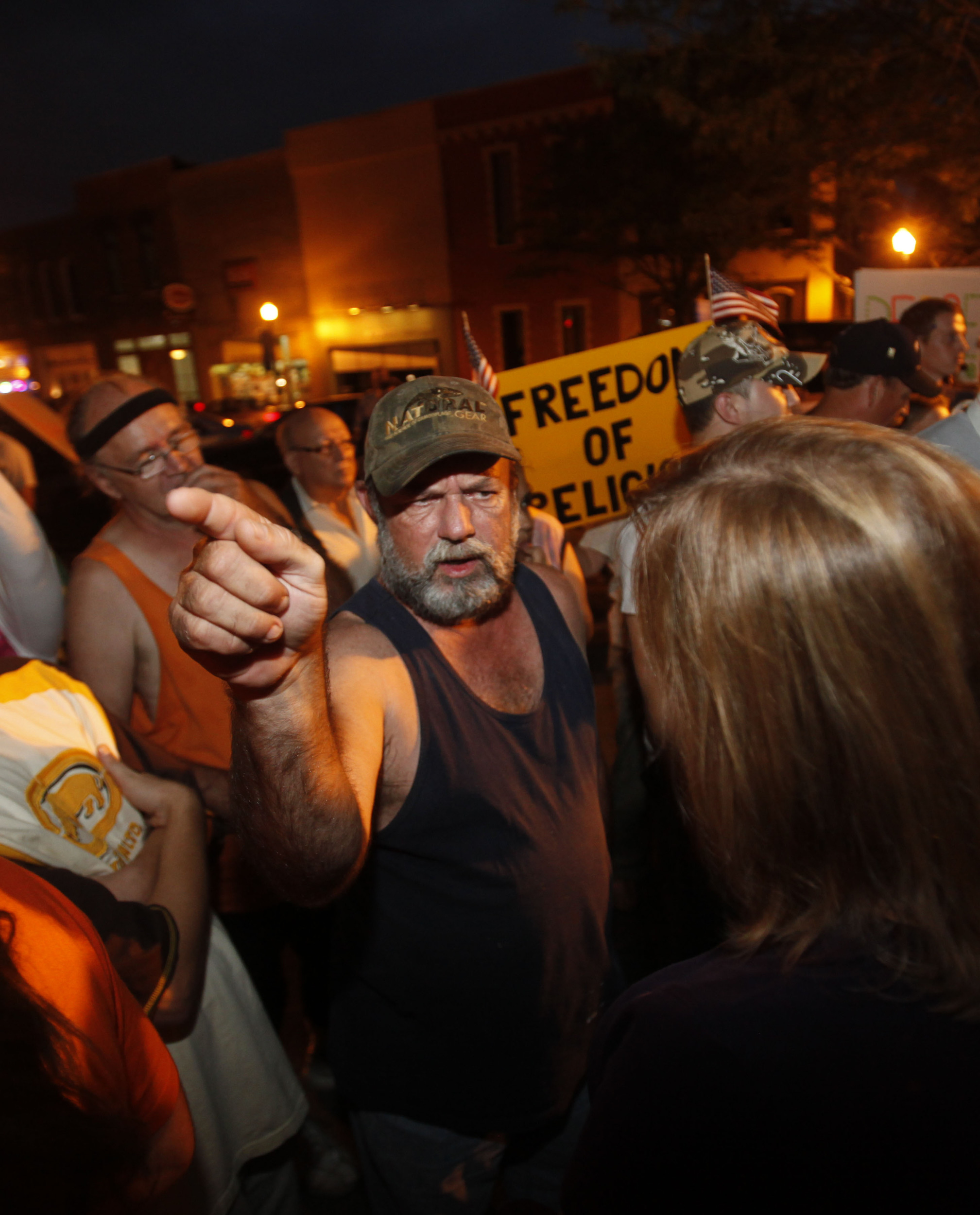 A protester argues against the proposed building of a mosque and community center in Murfreesboro, Tenn. A peace rally was held in support of the muslim community August 30, 2010 in public square.