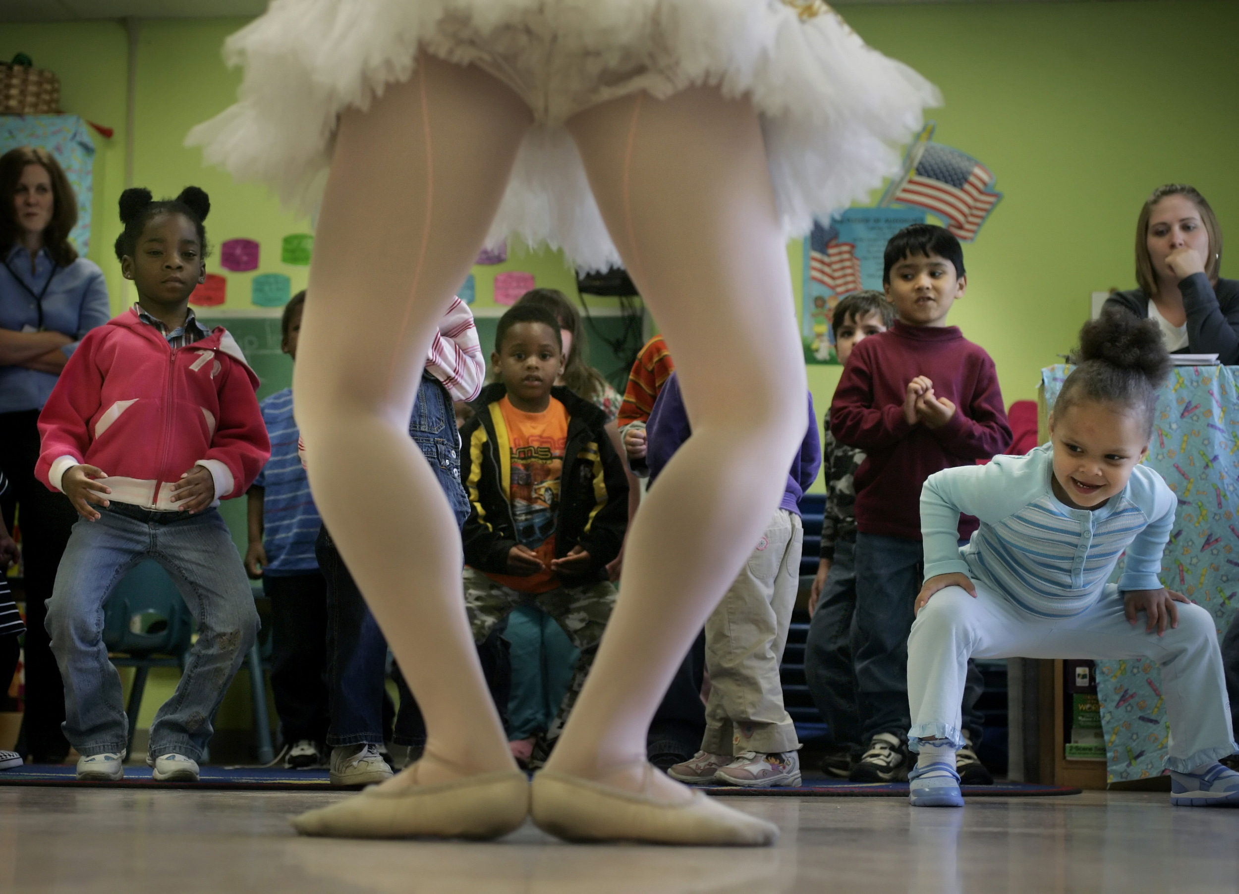 Whitney Edwards of the Nashville Ballet dances with children at Centerstone, a therapeutic pre-k program, in Nashville, Tenn.