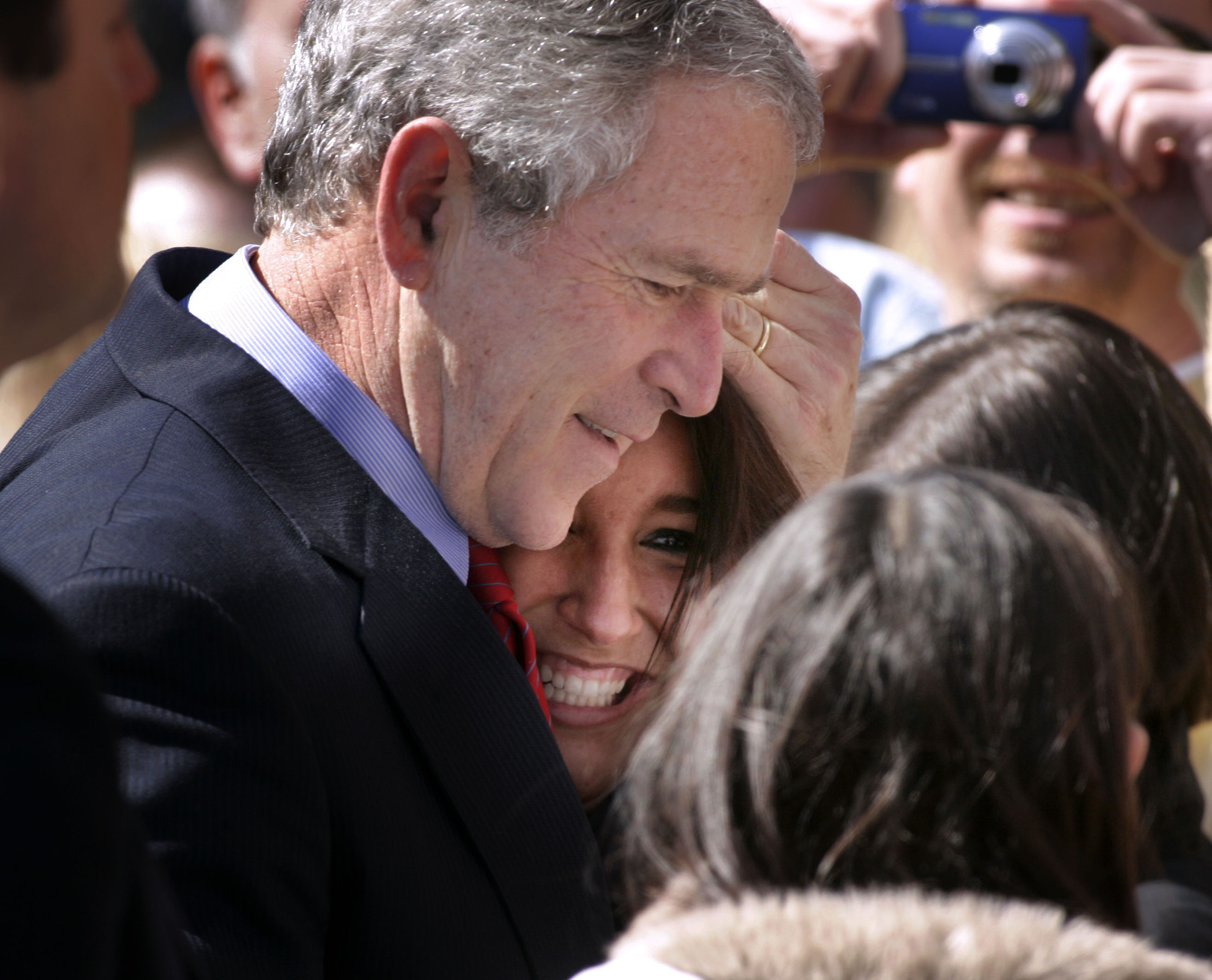 President George W. Bush hugs Courtney Harris of Lebanon before boarding Airforce One to depart Nashville  Tuesday, March 11, 2008 in Nashville, Tenn.