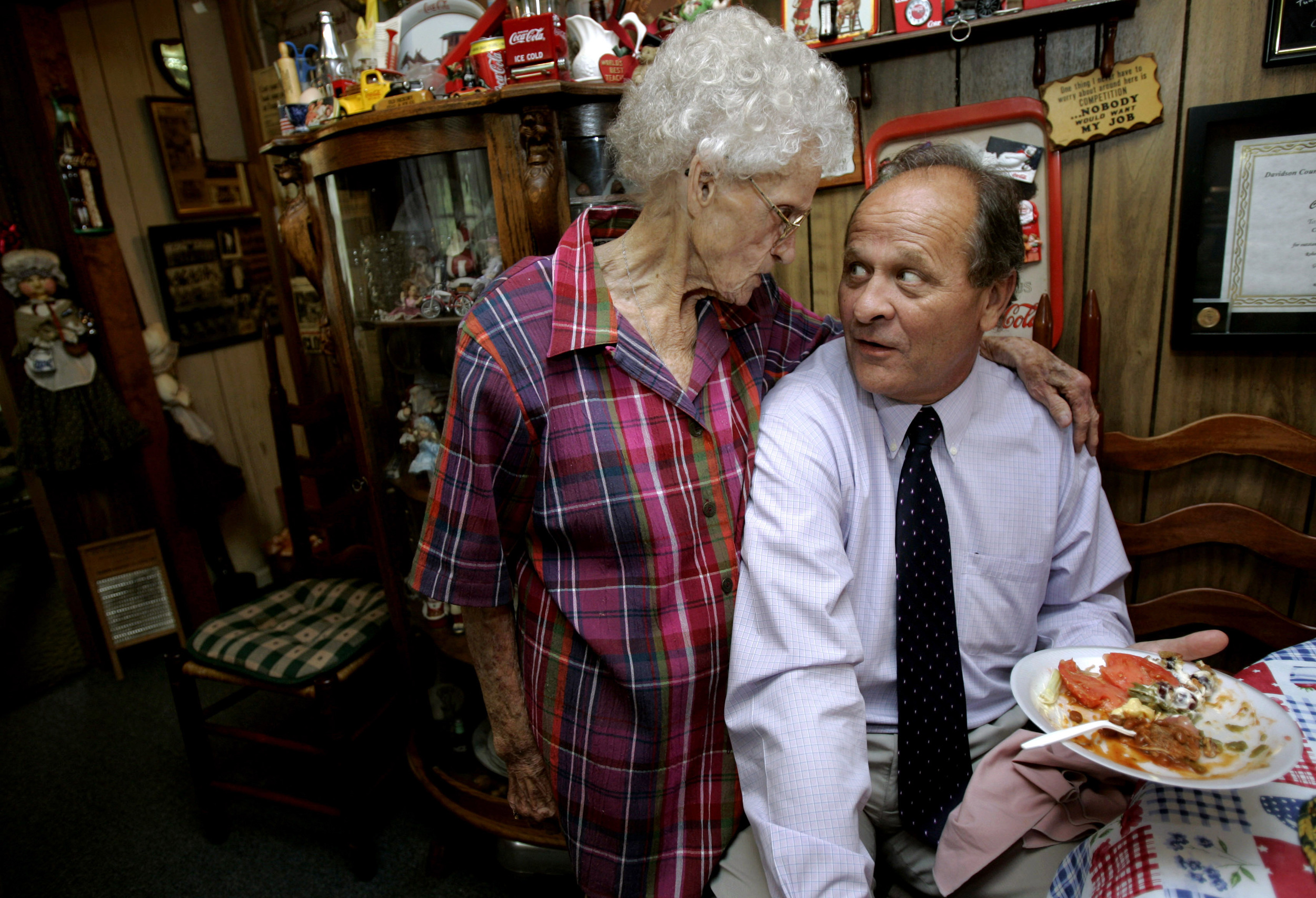 "Martha ""Mama"" Tune jokingly gives her former high school student Judge Randy Kennedy a stern look at her election day luncheon, an election tradition for politicos since 1988, Thursday, August 7, 2008 in Hermitage, Tenn."